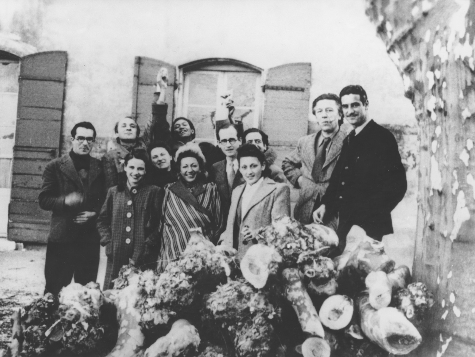 A group of artists pose around Varian Fry at the Villa Air-Bel outside Marseilles.  Among those pictured are Varian Fry (center wearing glasses), Daniel Benedite, Andre Breton, Jacqueline Lamba Breton, Jacques Herold and Wifredo Lam.