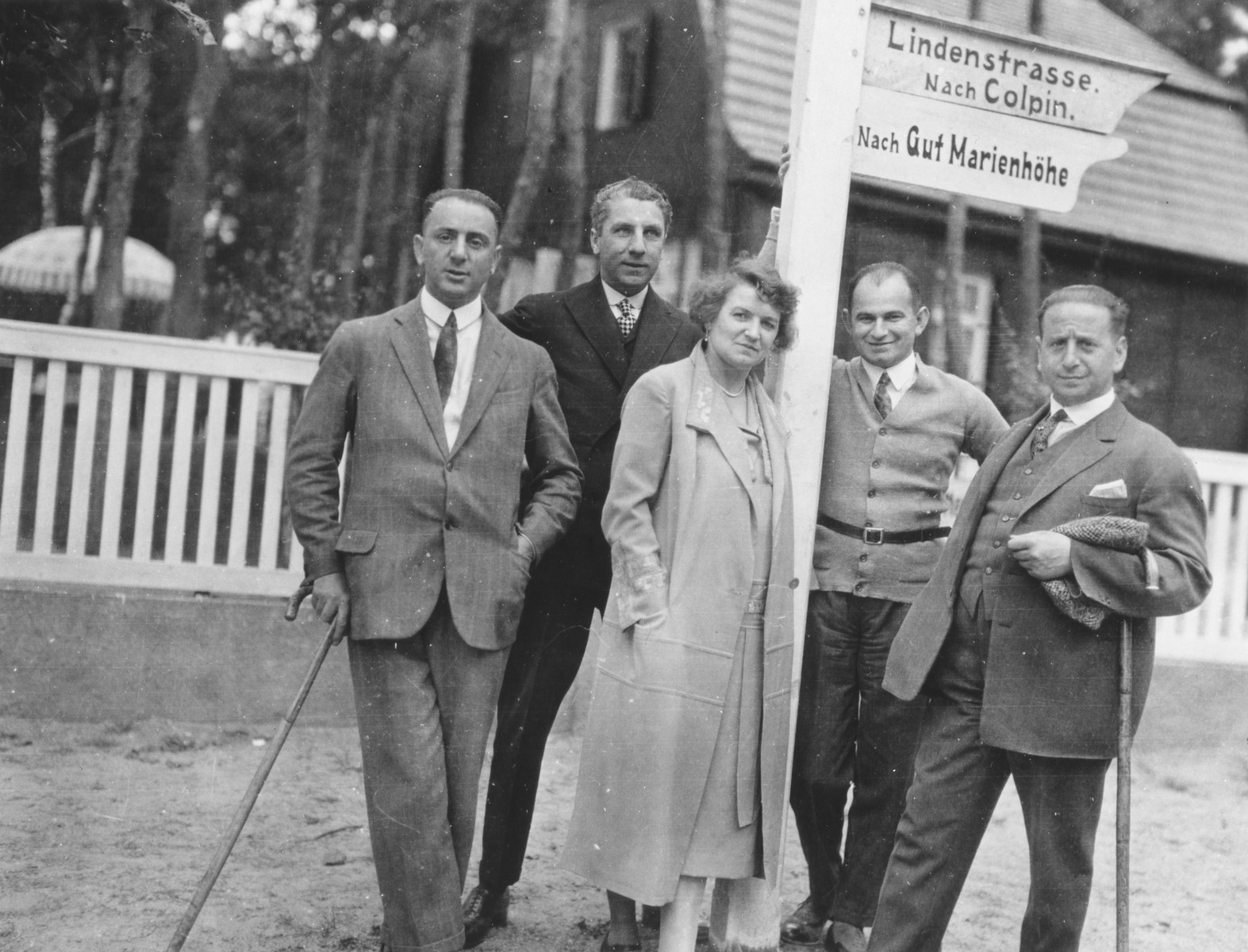 A group of German Jews poses next to a street sign in a resort town in Germany.  Among those pictured is Ludwig Plachte (at the left) and Mr. Salomon, Ludwig's business partner (on the right).