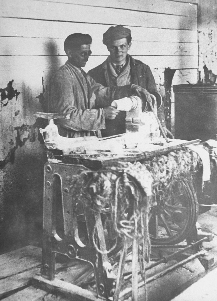 Samuel Kruk with another inmate in a leather workshop in the Targu-Jiu labor camp, which housed Jews and communists.
