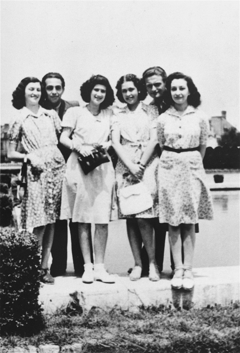 Group portrait of young Jewish men and women in a park in Bucharest.    Among those pictured are Jeanine Gutman (far right) and Valerie Zigmund (Cernes) (third from the left).  Both Jeanine and Valerie survived the war.