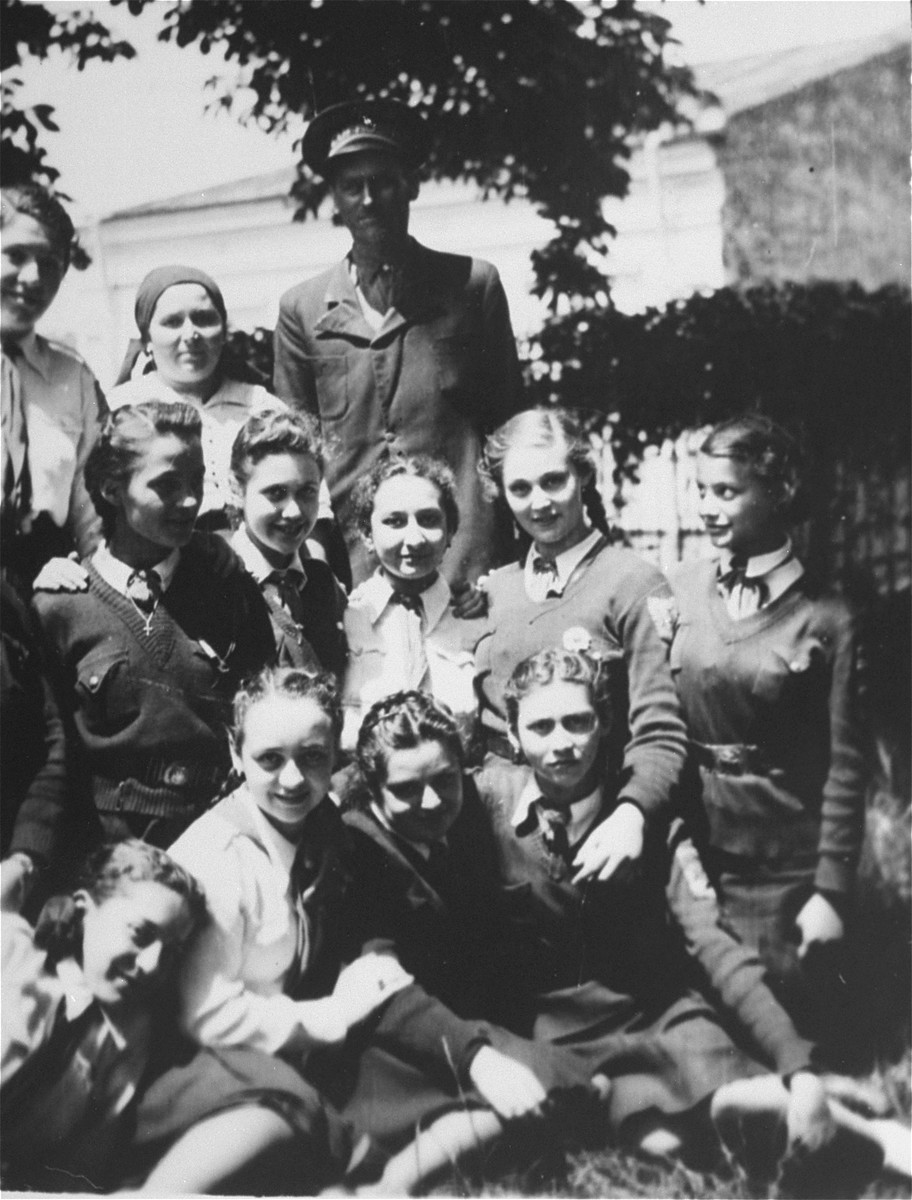 Group portrait of Jewish students in Bucharest, Romania.  Among those pictured is Jeanine Gutman (kneeling in the second row in the middle).