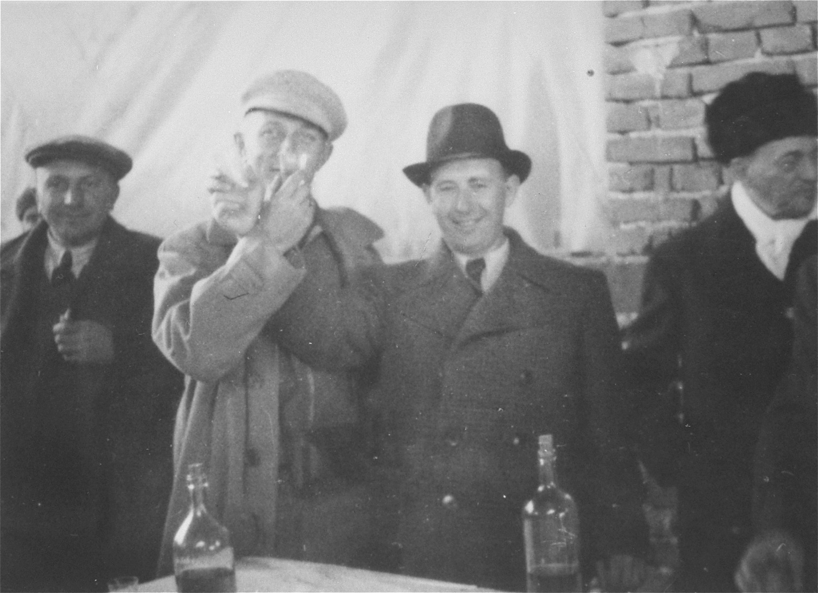 A group of men toast the opening of a new wood manufacturing factory in Gugesti, Romania.  Among those pictured is Beno Kupferman (second from the right).