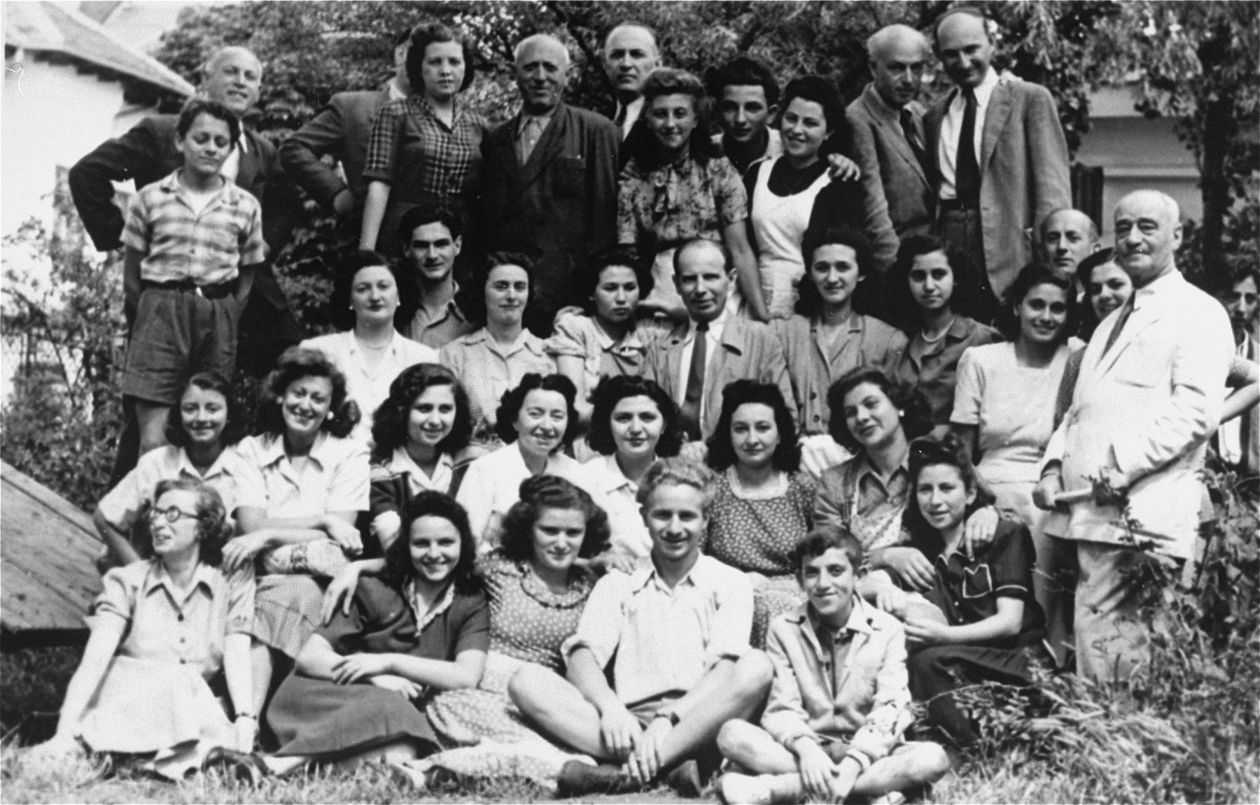 Group portrait of Jewish students attending a book-binding course in Bacau, Romania.   Among those pictured is Jeanine Gutman (second row, third from the right).  This school was one of many organized by the Jewish community after Jewish youth were excluded from the Romanian school system.