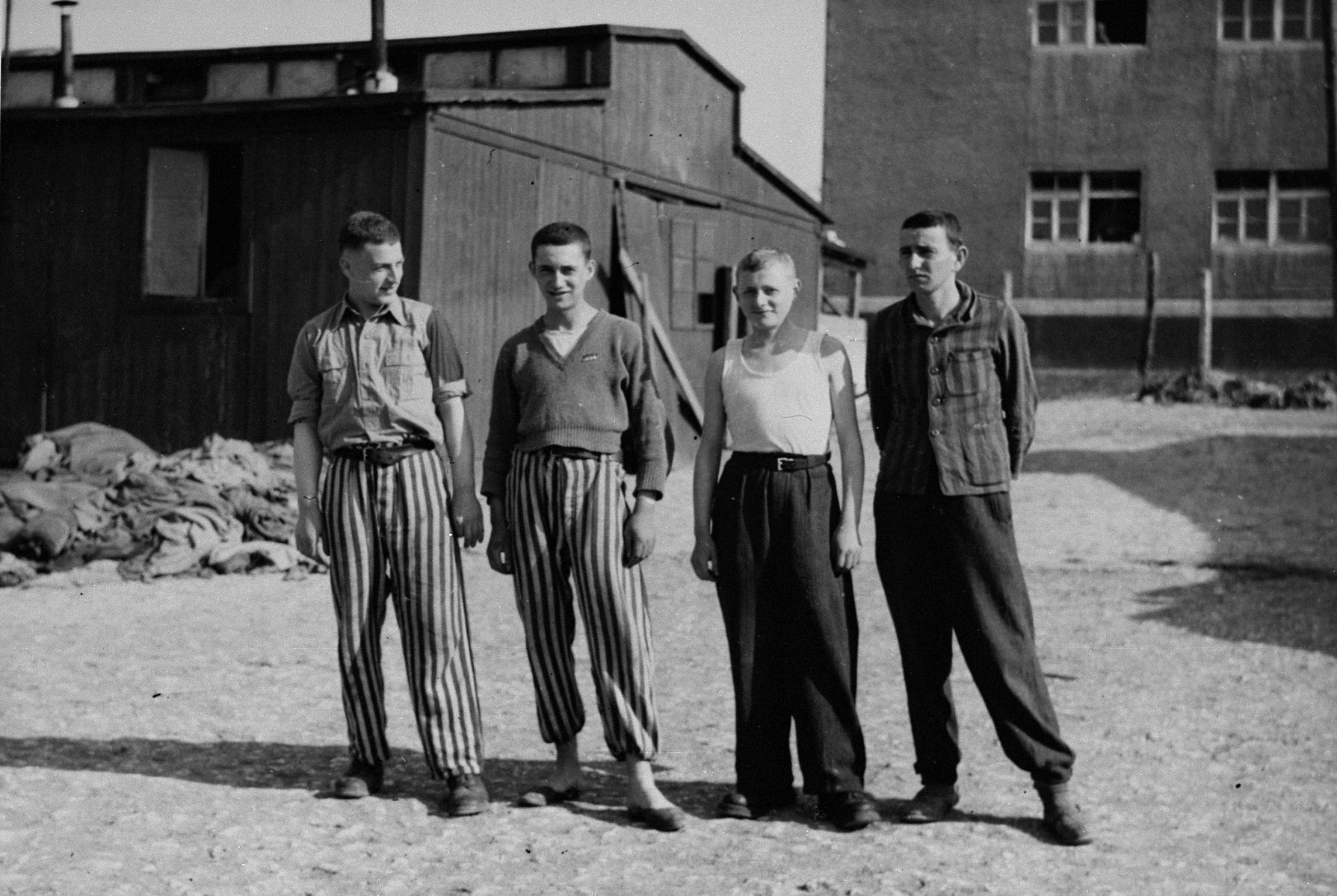 Portrait of four young survivors in Buchenwald concentration camp.