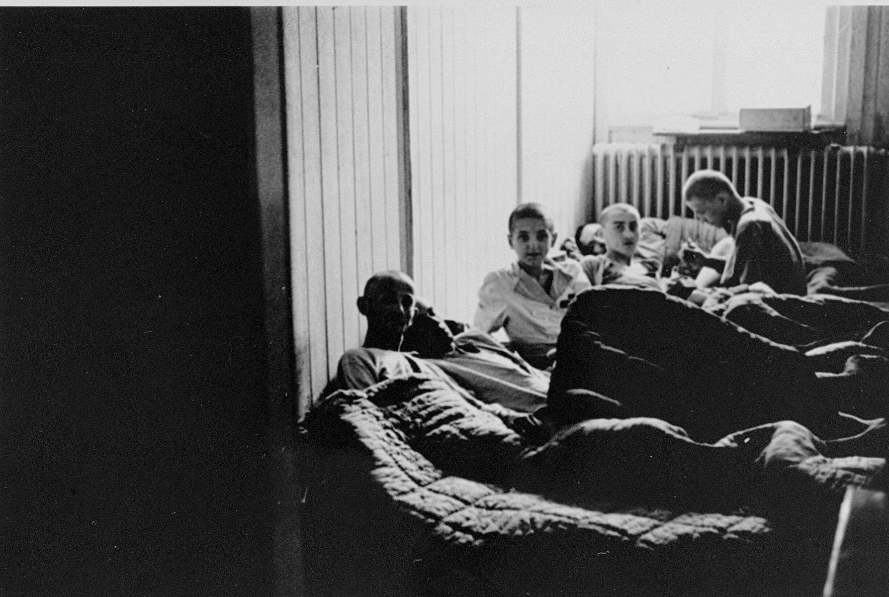 Survivors rest on mattresses in a make-shift infirmary in Buchenwald.