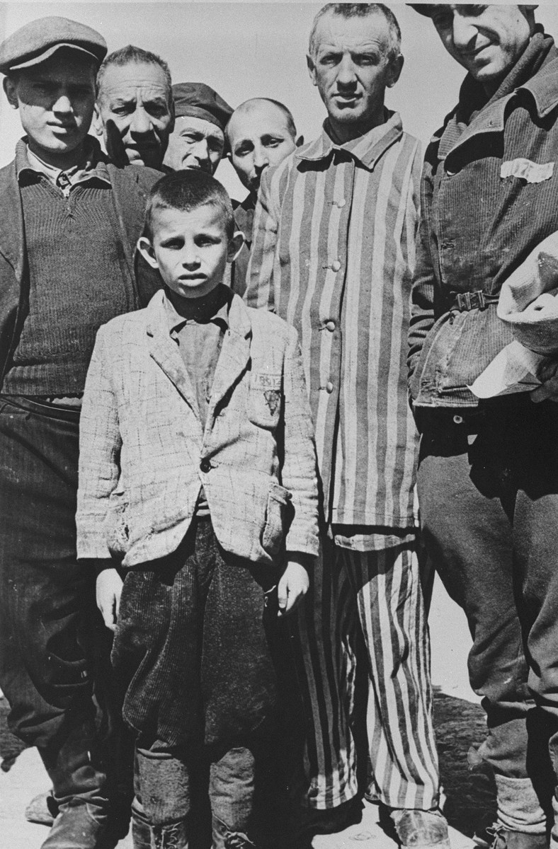 A group of survivors, including a young boy, in Buchenwald after liberation.