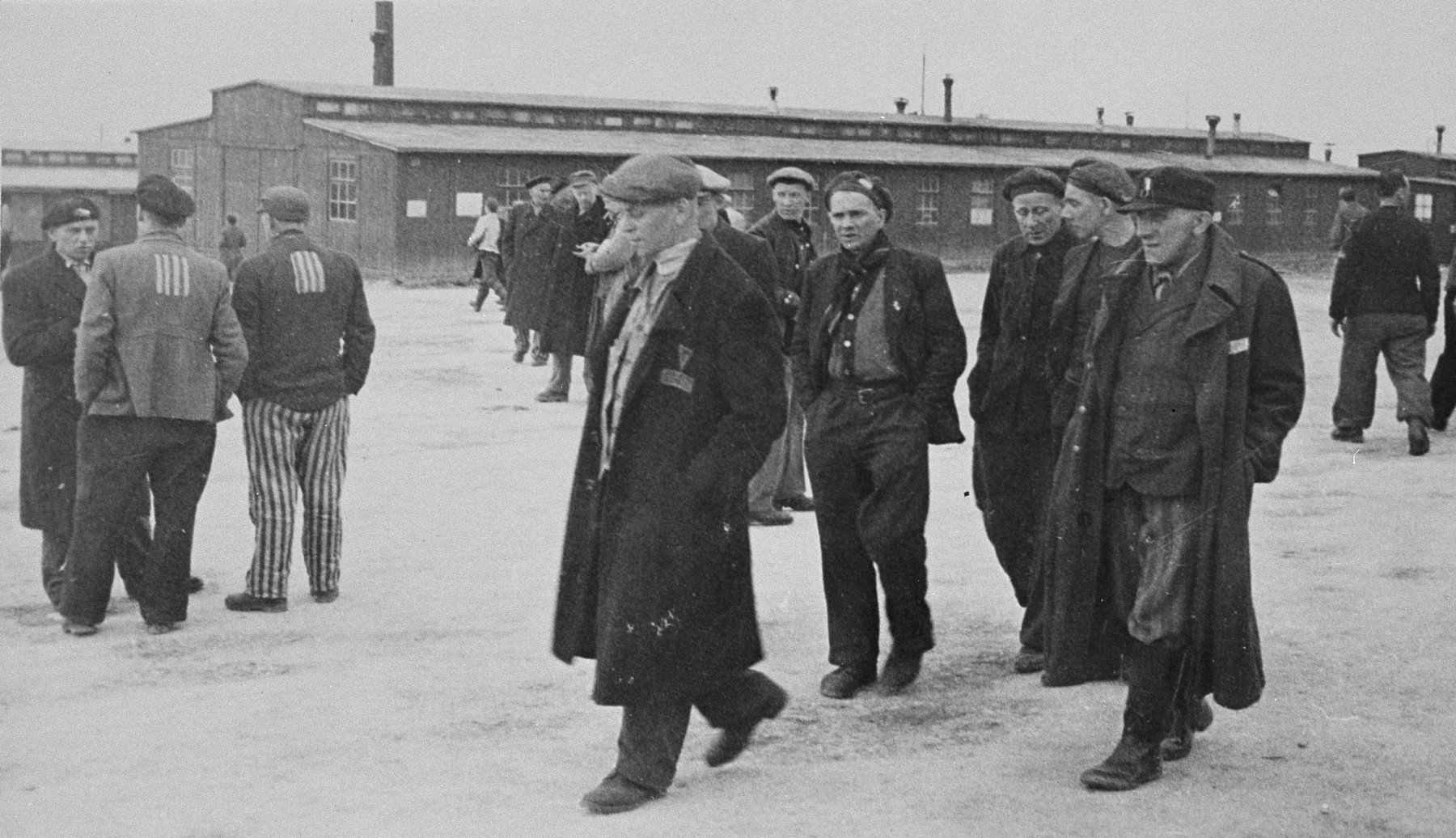 Survivors walk though the Buchenwald concentration camp after liberation.