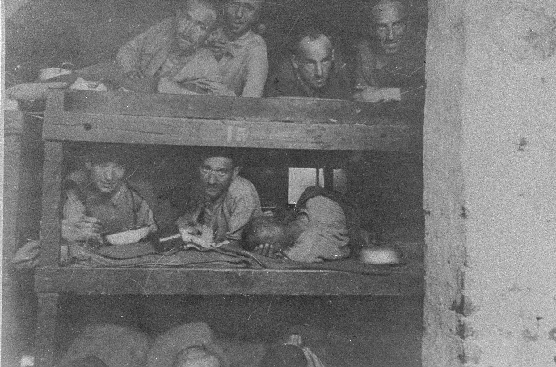 Survivors in Buchenwald who are still too weak to leave lie in their bunks.