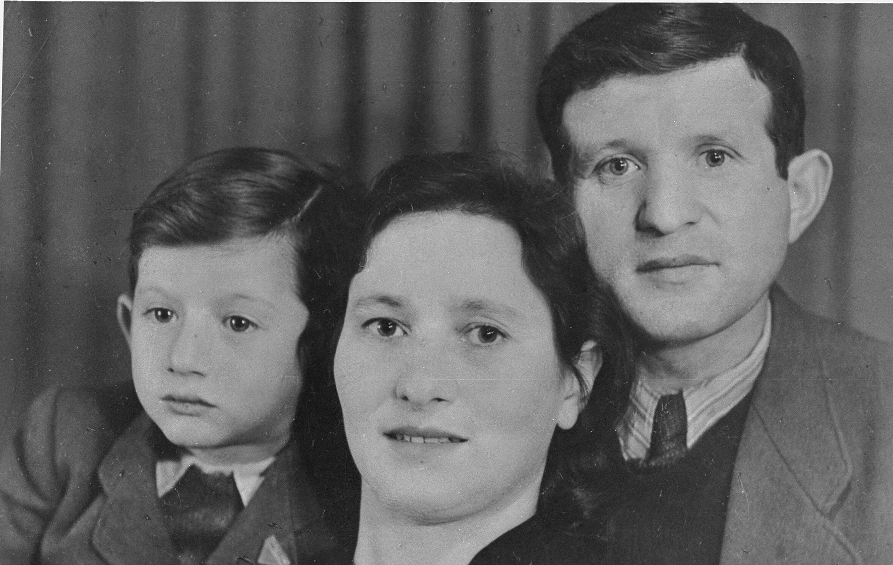 Portrait of a Jewish DP family in postwar Germany.  Pictured are Israel and Esther Schleifstein with their son Joseph.