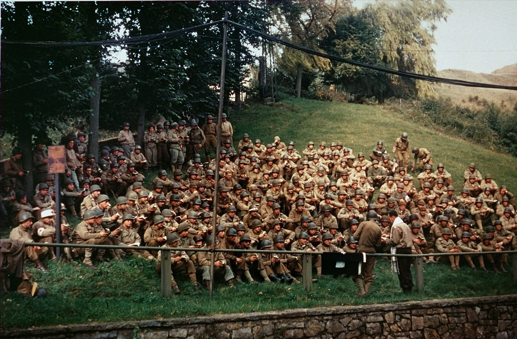 Jewish soldiers in the American Army attend High Holiday services on a hillside near the newly established Seventh Corps headquarters in Kornelimünster, near Aachen, Germany.  Among those pictured is Rabbi Sidney Leskowitz.