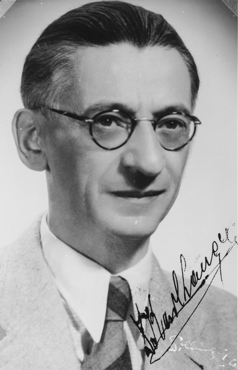 """Autographed portrait of Dr. Karl Langer, a member of the International Committee for European Immigrants in Shanghai.  One photograph from the International Committee album, """"Introducing the I.C. Staff"""" presented to I.C. secretary Paul Komor on August 7, 1941 in Shanghai."""