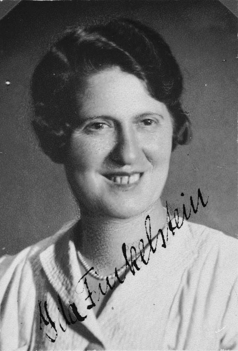 """Autographed portrait of Ida Finkelstein, a member of the International Committee for European Immigrants in Shanghai.  One photograph from the International Committee album, """"Introducing the I.C. Staff"""" presented to I.C. secretary Paul Komor on August 7, 1941 in Shanghai."""