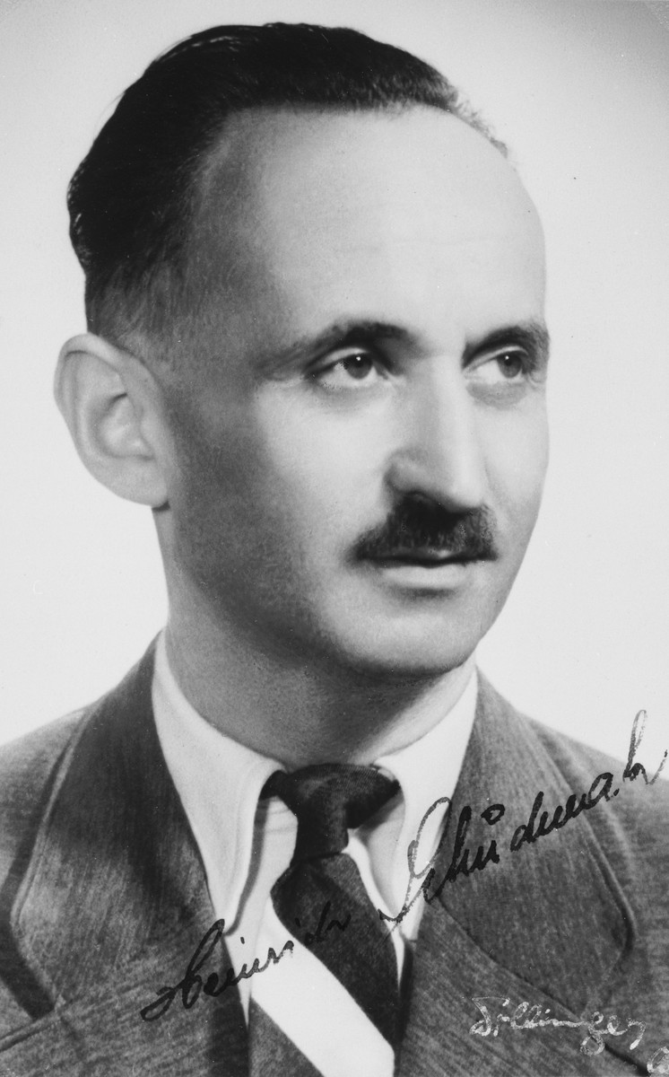 """Autographed portrait of Heinrich Schudmak, a member of the International Committee for European Immigrants in Shanghai.  One photograph from the International Committee album, """"Introducing the I.C. Staff"""" presented to I.C. secretary Paul Komor on August 7, 1941 in Shanghai."""