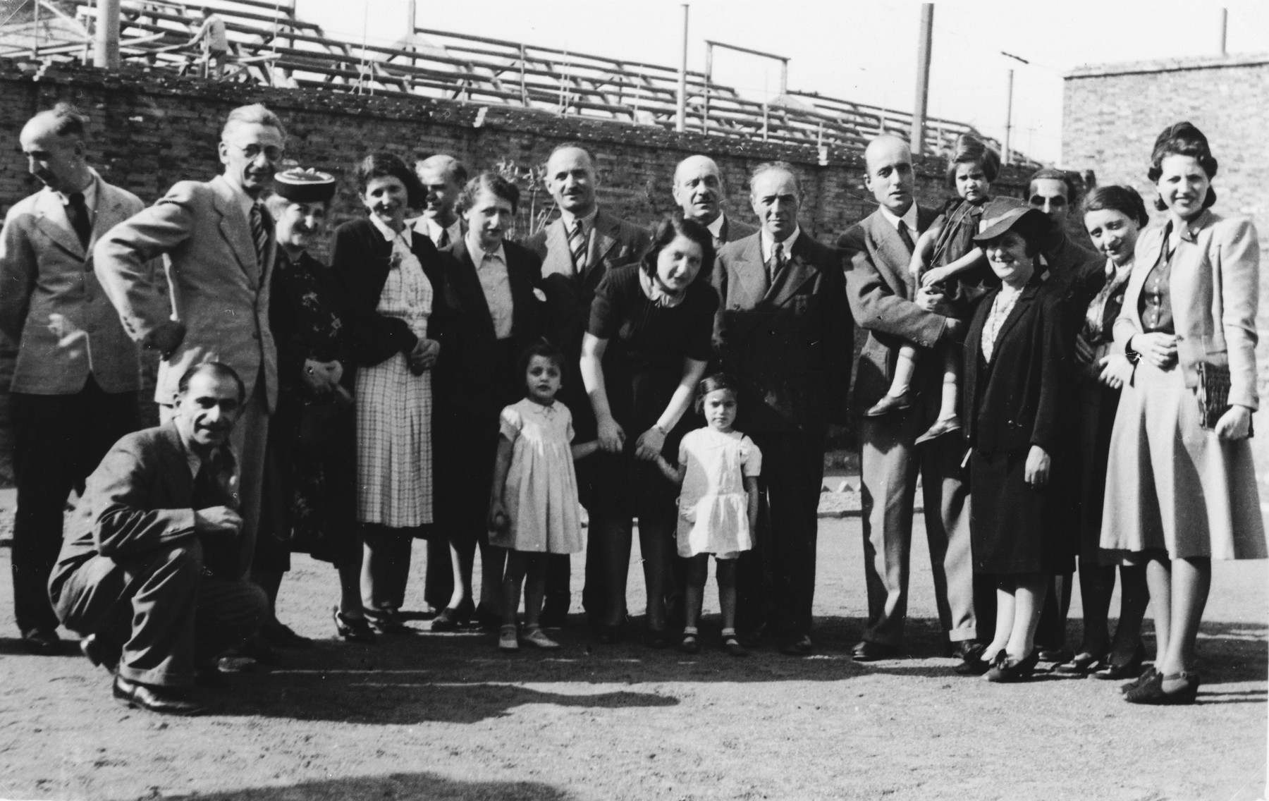 Members of the International Committee for European Immigrants pose with refugee children during a visit to the I.C. creche for Jewish refugee children in Shanghai.  One photograph from a second International Committee album prepared for I.C. secretary Paul Komor.
