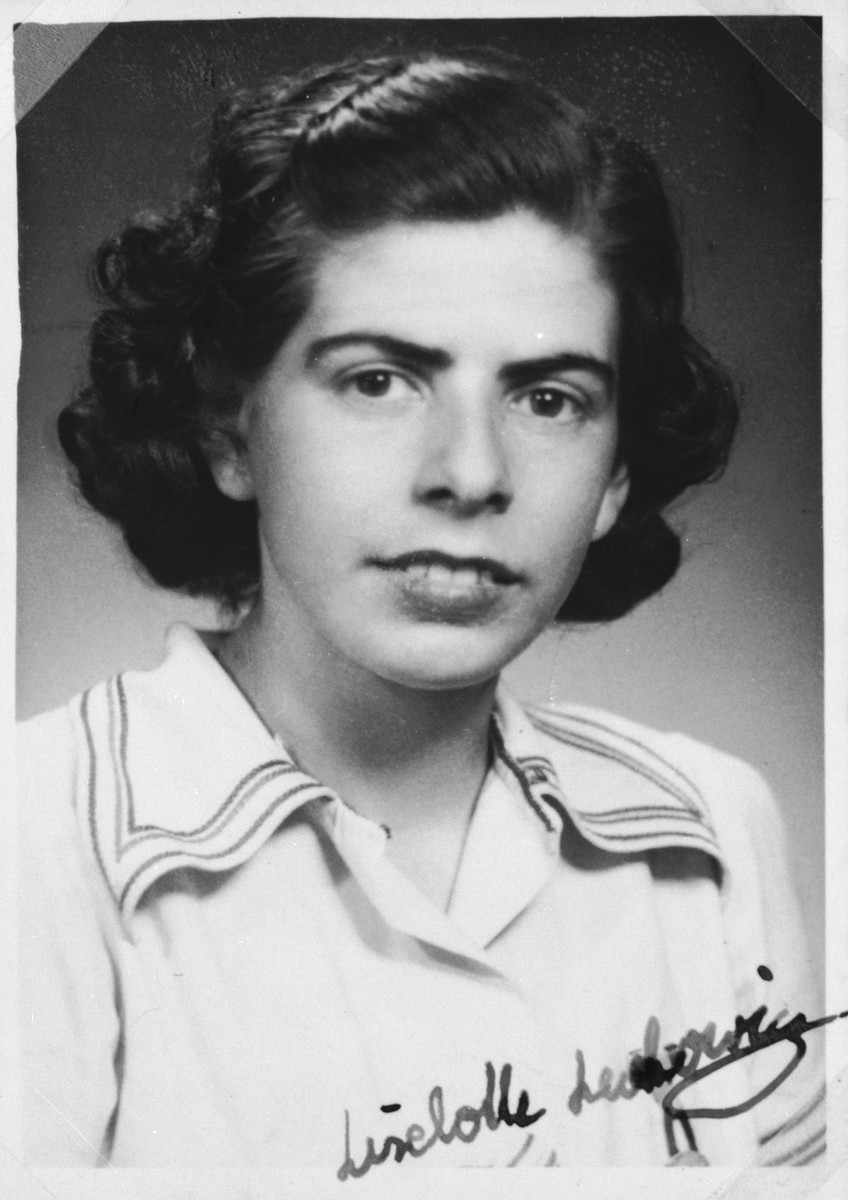 """Autographed portrait of Liselotte Lewkowicz, a member of the International Committee for European Immigrants in Shanghai.  One photograph from the International Committee album, """"Introducing the I.C. Staff"""" presented to I.C. secretary Paul Komor on August 7, 1941 in Shanghai."""