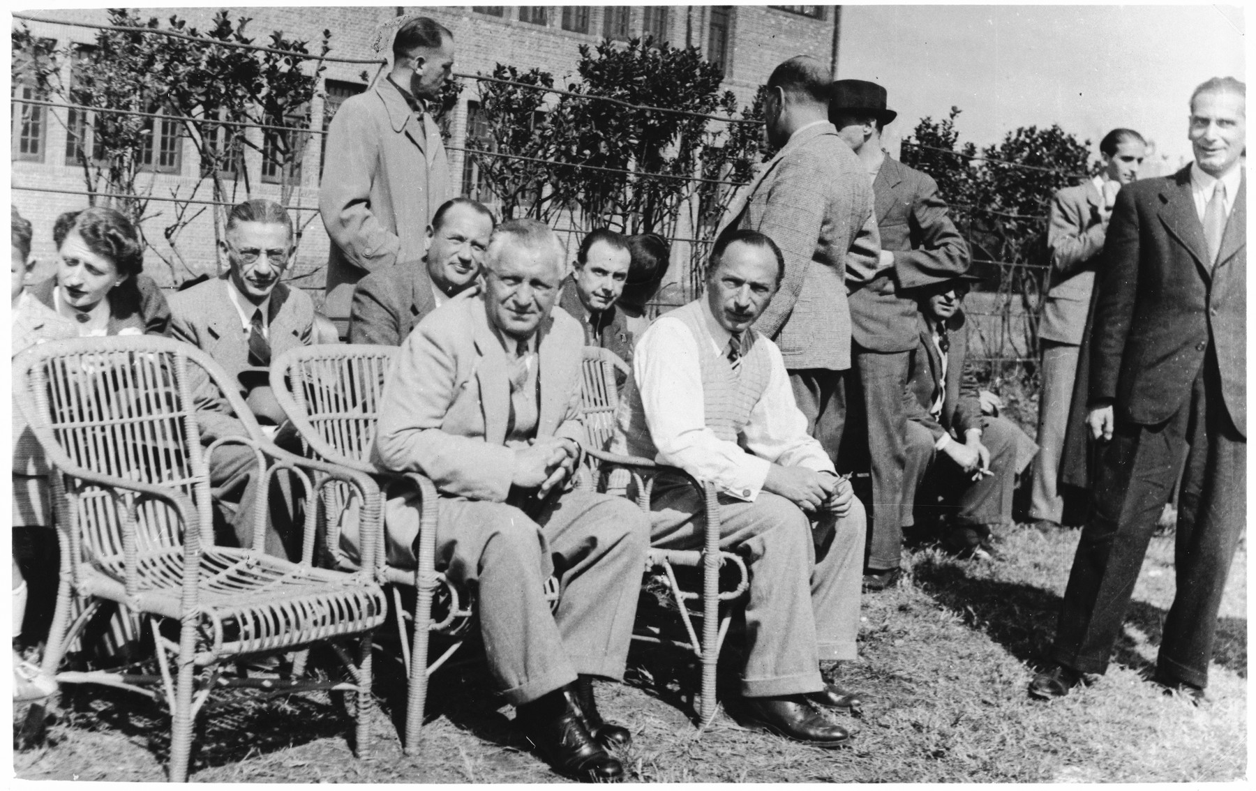 Paul Komor (seated in the front row, second from the left) attends a soccer match between the I.C. and Shanghai Jewish Chronicle teams in Shanghai.  The soccer match was held as a fundraiser for the I.C.'s Milk Fund.  One photograph from a second International Committee album prepared for I.C. secretary Paul Komor.