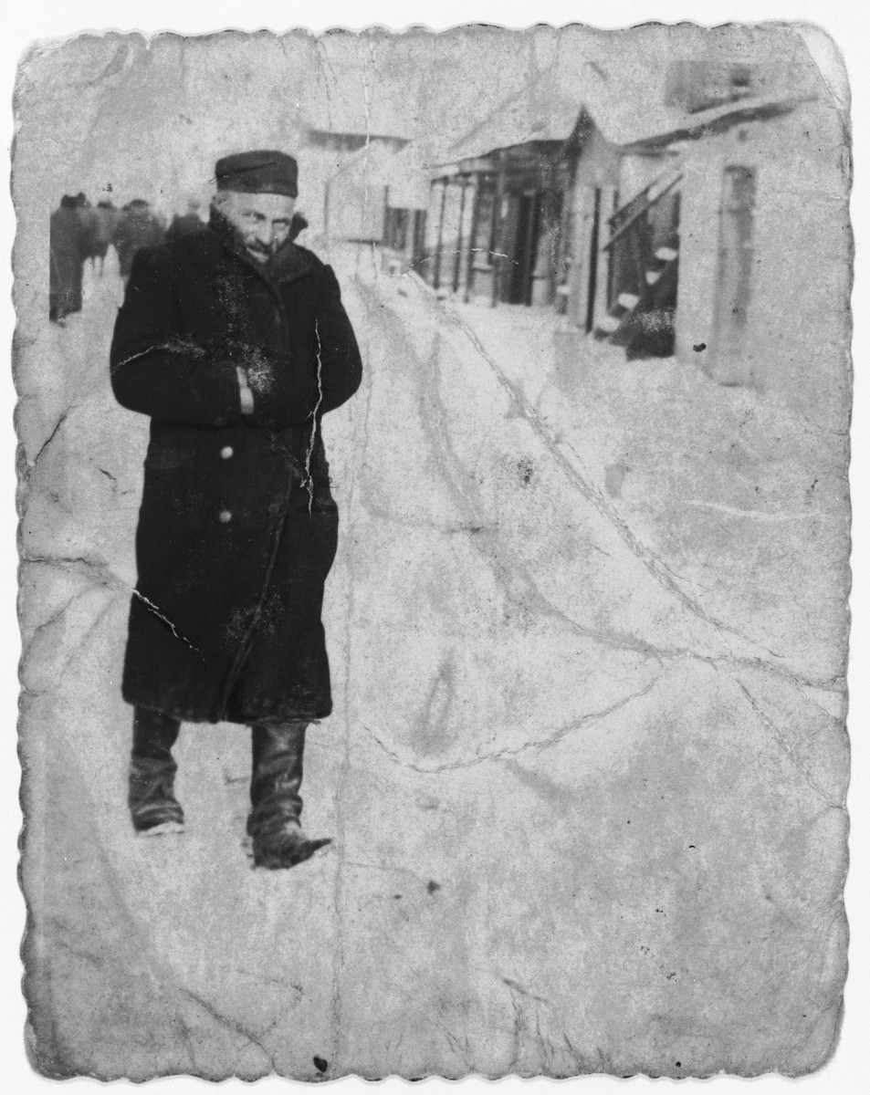 Moshe Lachter wrapped in a winter coat and boots returns home from the synagogue after morning prayers.