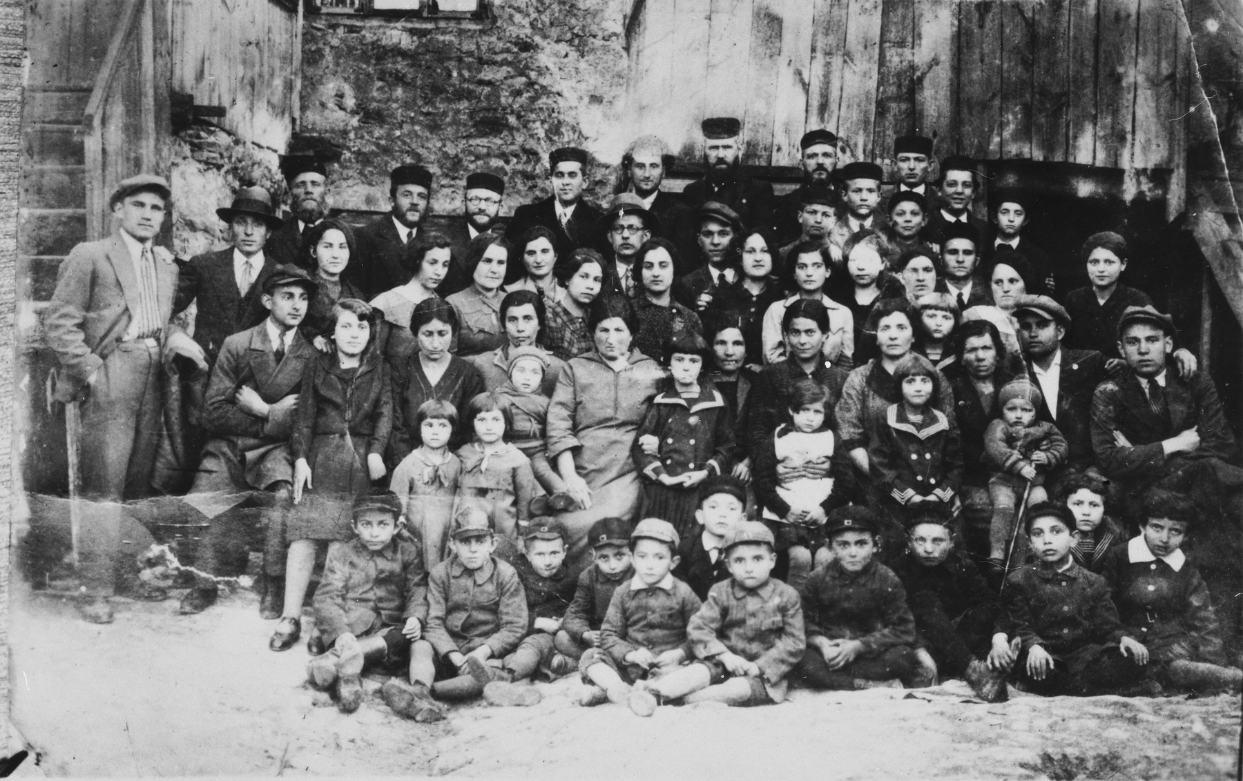 Group portrait of the extended family of Mottle Leichter in Janow Podlaski, Poland.    The photo was taken on the occasion of the departure of one family member to Palestine.  Only three of those pictured survived the Holocaust, including two who left Poland before the war.
