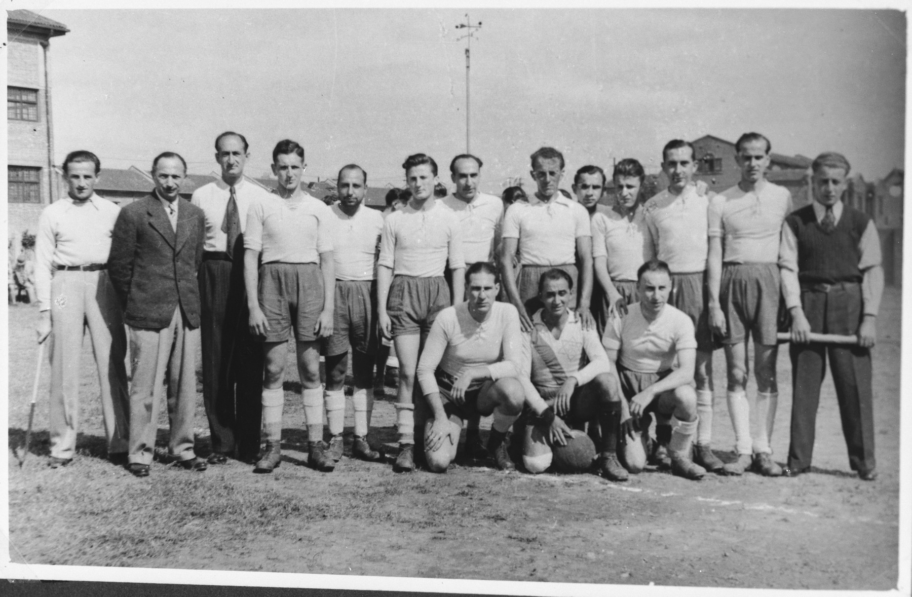 Paul Komor (standing second from the left) poses with members of the International Committee soccer team at a match between the I.C. and Shanghai Jewish Chronicle teams in Shanghai.  The soccer match was held as a fundraiser for the I.C.'s Milk Fund.  One photograph from a second International Committee album prepared for I.C. secretary Paul Komor.