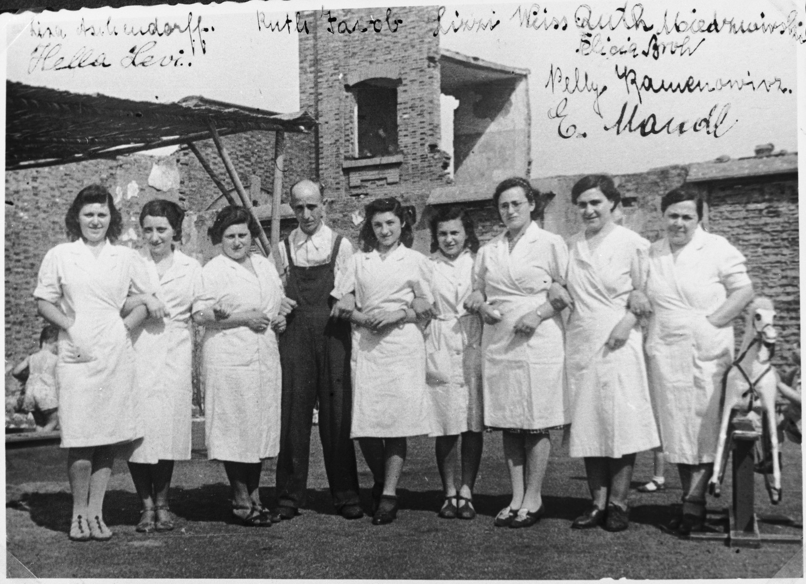 """Group portrait of members of the International Committee for European Immigrants in Shanghai who staff the I.C. creche for Jewish refugees.  Among those pictured is Lotte Guttmann.  One photograph from the International Committee album, """"Introducing the I.C. Staff"""" presented to I.C. secretary Paul Komor on August 7, 1941 in Shanghai."""