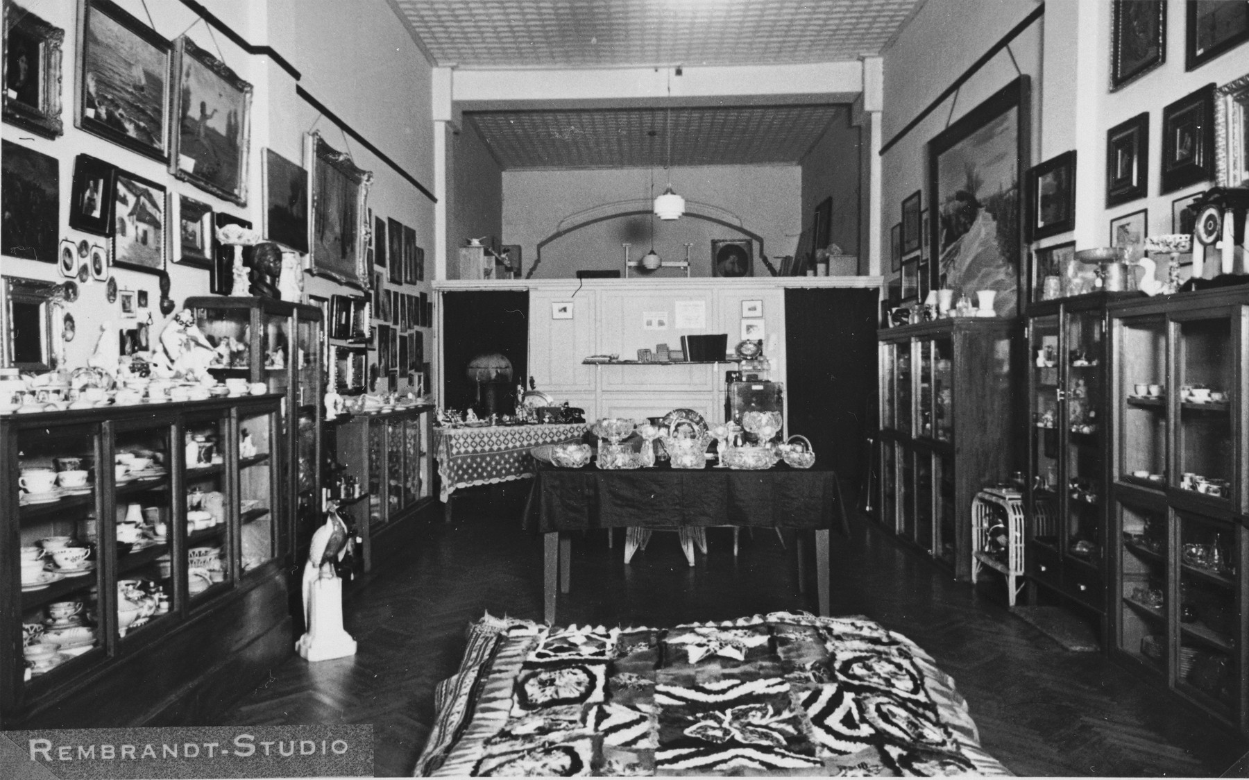 Interior of the thrift shop set up at the Cathay Hotel in Shanghai by the International Committee for European Immigrants to facilitate the sale of personal property owned by Jewish refugees who fled to Shanghai.  One photograph from a second International Committee album prepared for I.C. secretary Paul Komor.