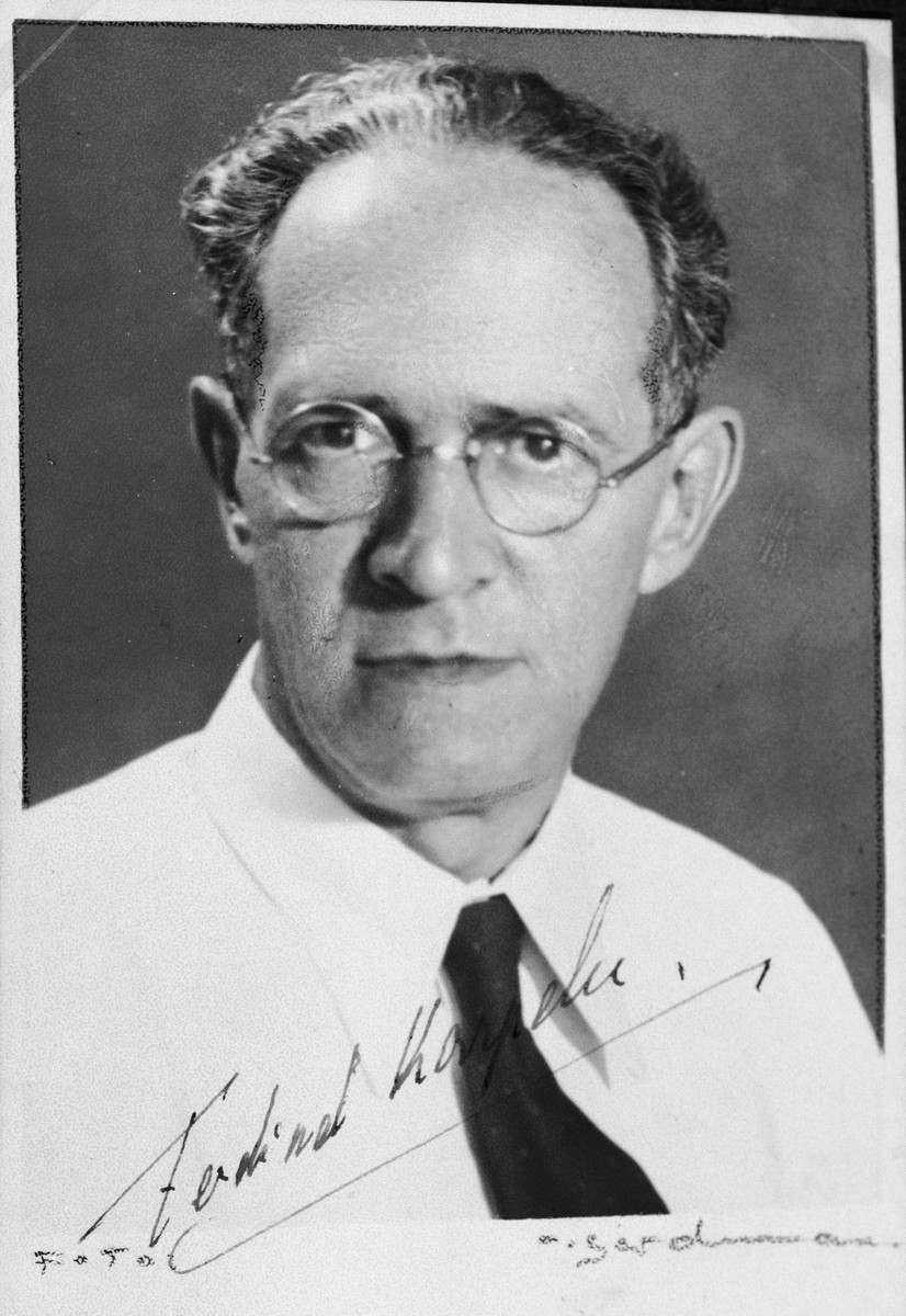 """Autographed portrait of Ferdinand Karpeles, a member of the International Committee for European Immigrants in Shanghai.  One photograph from the International Committee album, """"Introducing the I.C. Staff"""" presented to I.C. secretary Paul Komor on August 7, 1941 in Shanghai."""