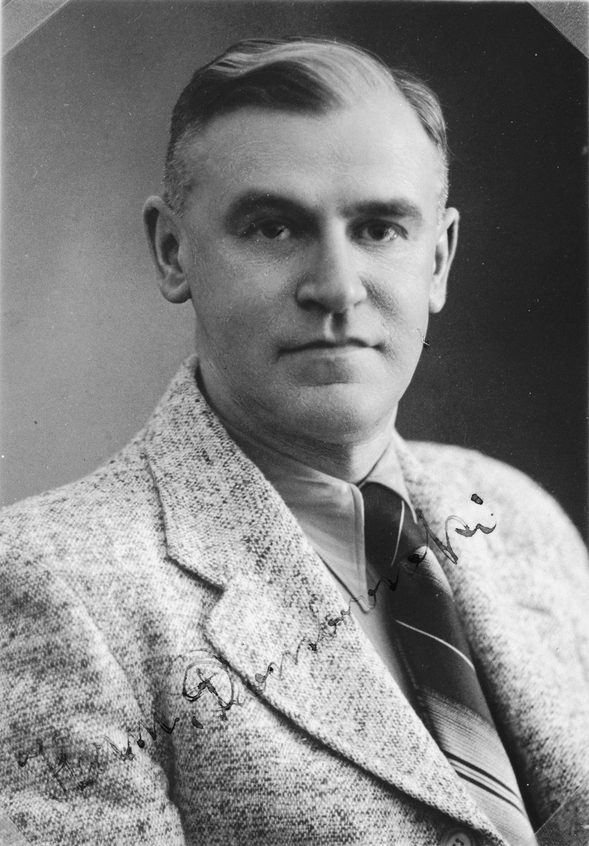 """Autographed portrait of Hermann Dombrowski, a member of the International Committee for European Immigrants in Shanghai.  One photograph from the International Committee album, """"Introducing the I.C. Staff"""" presented to I.C. secretary Paul Komor on August 7, 1941 in Shanghai."""