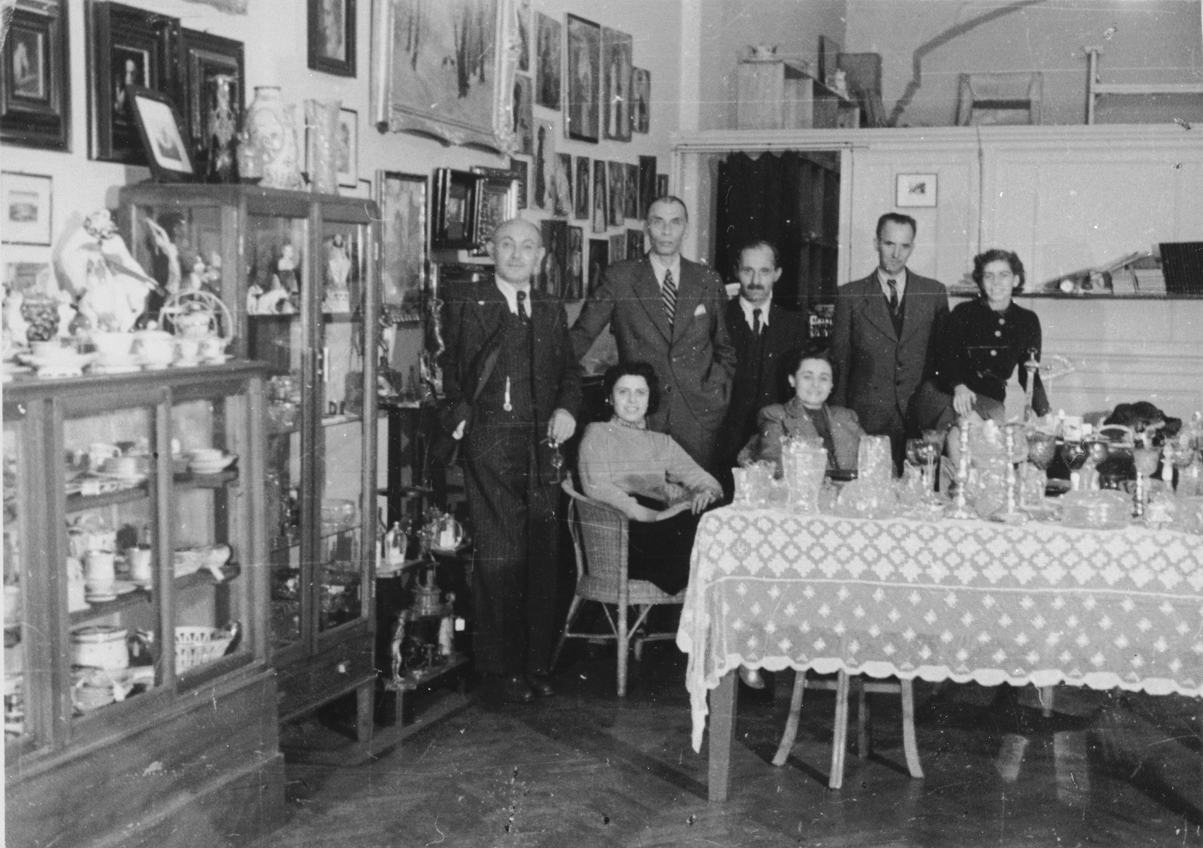 Members of the International Committee for European Immigrants pose in the thrift shop set up by the I.C. in the Cathay Hotel to facilitate the sale of personal property owned by Jewish refugees who fled to Shanghai.  One photograph from a second International Committee album prepared for I.C. secretary Paul Komor.