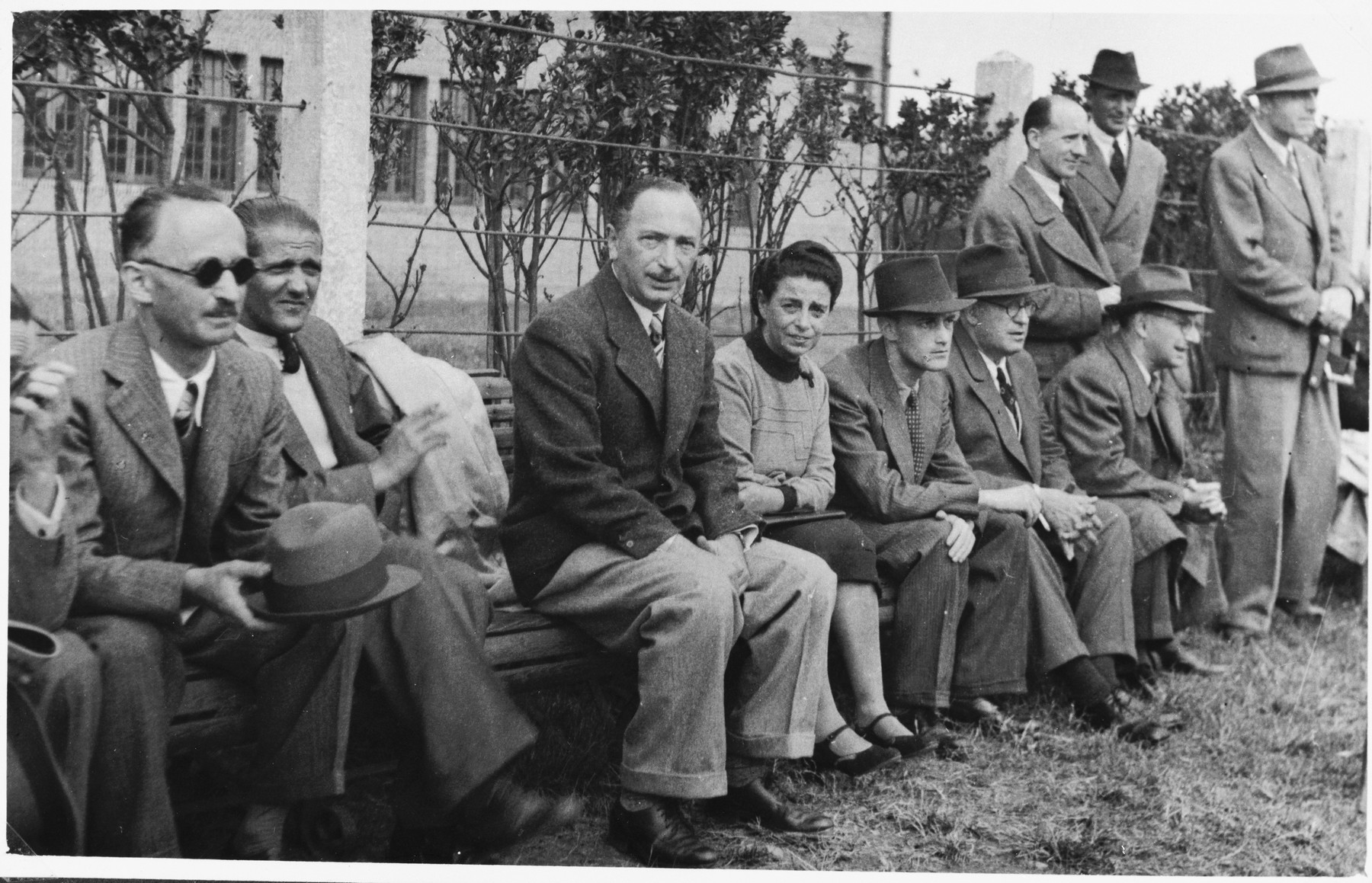 Paul Komor (third from the left) attends a soccer match between the I.C. and Shanghai Jewish Chronicle teams in Shanghai.  The soccer match was held as a fundraiser for the I.C.'s Milk Fund.  One photograph from a second International Committee album prepared for I.C. secretary Paul Komor.
