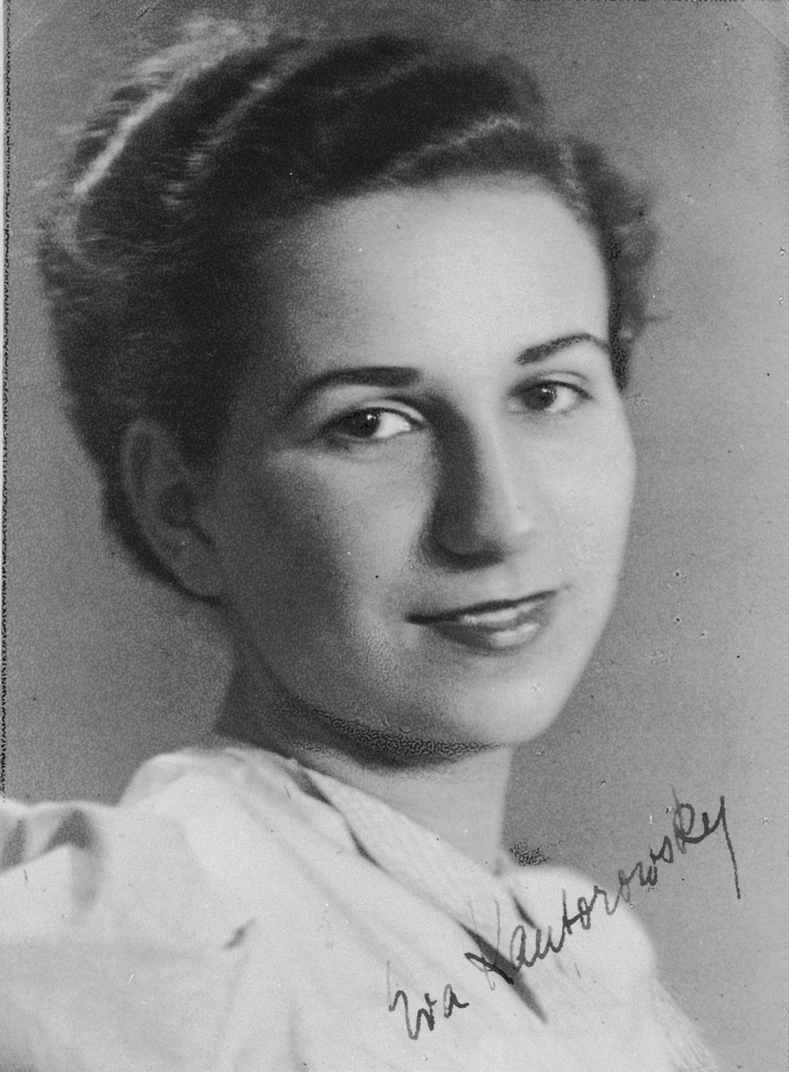 """Autographed portrait of Eva Kantorowski, a member of the International Committee for European Immigrants in Shanghai.  One photograph from the International Committee album, """"Introducing the I.C. Staff"""" presented to I.C. secretary Paul Komor on August 7, 1941 in Shanghai."""