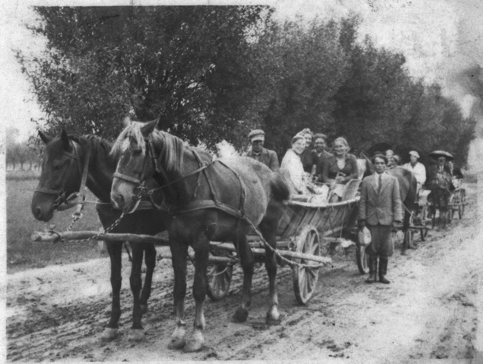 A group of Jews from Turobin travel by horse-drawn wagon to a wedding in a neighboring town.
