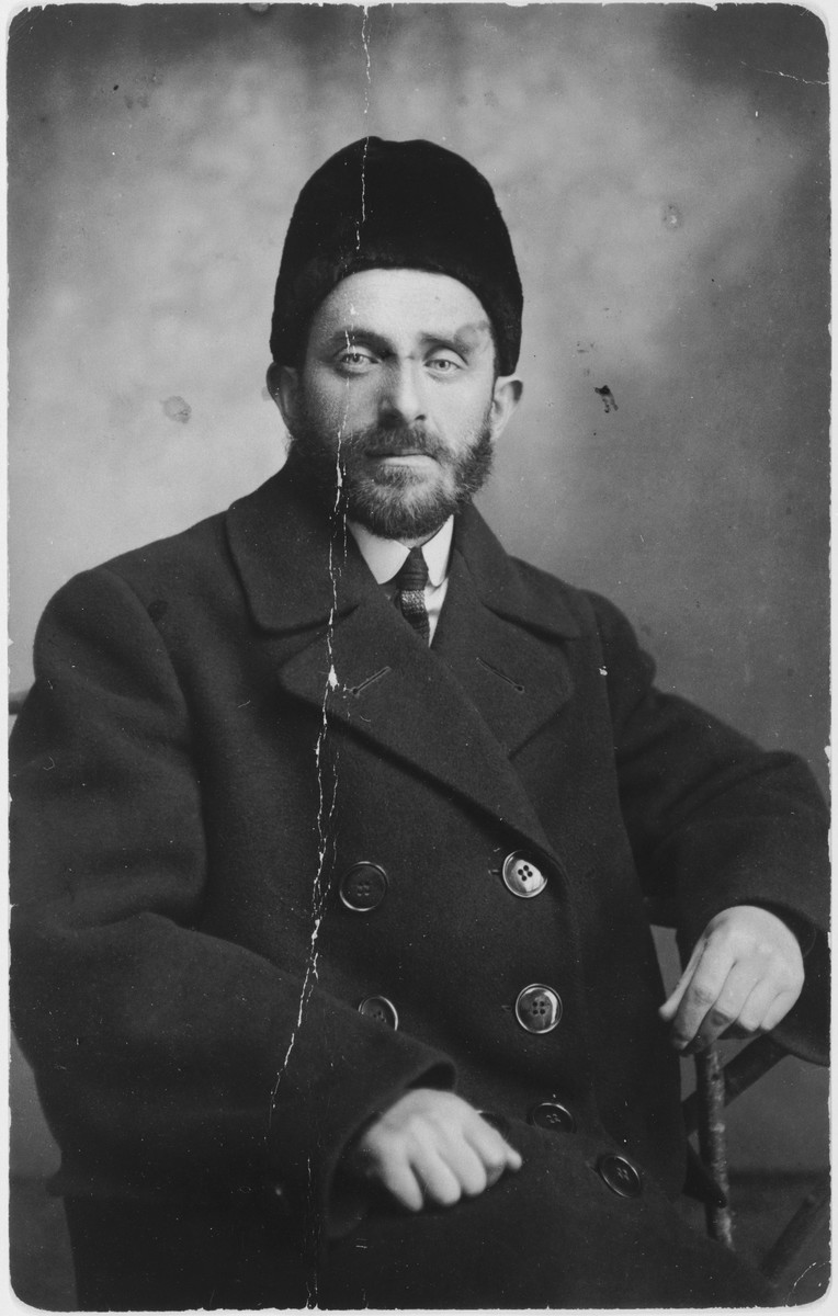Studio portrait of a Jewish merchant from Turobin, Poland.  Pictured is Pesach Dimant, an uncle of Izak Lachter. Pesach Dimant was a prosperous lumber merchant before the war.  Following the German invasion of Turobin in September 1939, Pesach and his younger brother were summoned to appear at their wood mill.  They both were shot as soon as they arrived.