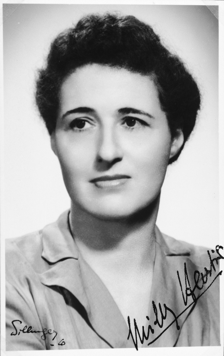 "Autographed portrait of Milly Hartig, a member of the International Committee for European Immigrants in Shanghai.  One photograph from the International Committee album, ""Introducing the I.C. Staff"" presented to I.C. secretary Paul Komor on August 7, 1941 in Shanghai."
