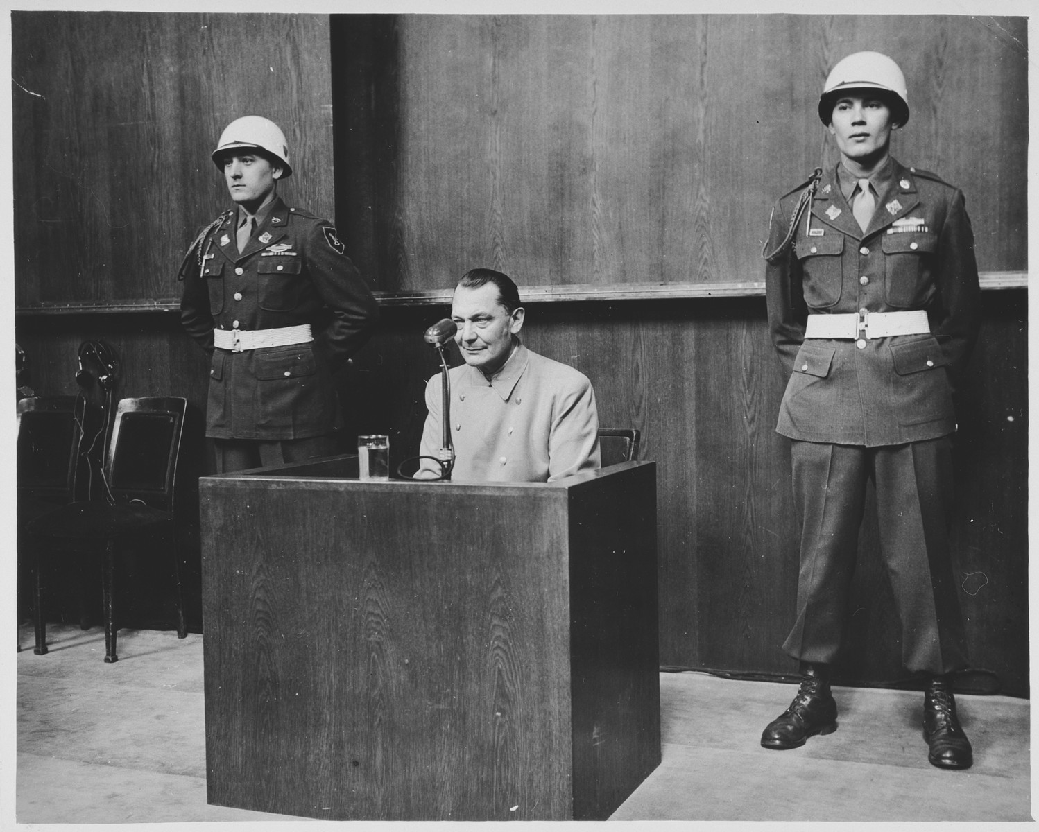 Flanked by two military policemen, Hermann Goering testifies at the International Military Tribunal trial of war criminals at Nuremberg.