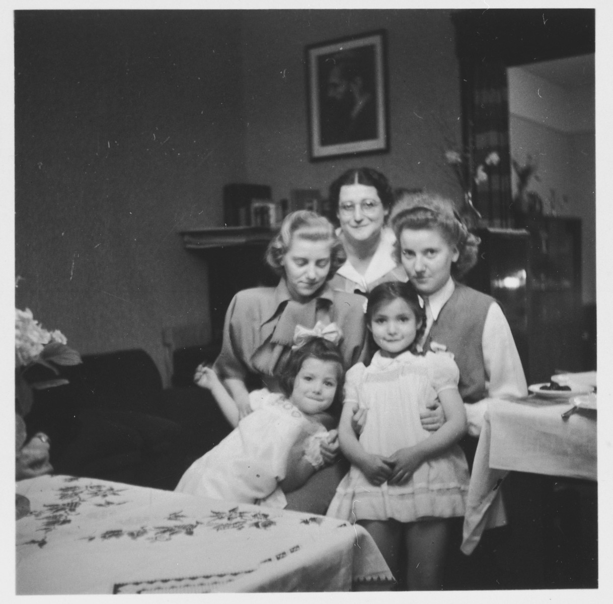 Group portrait of members of the Wollheim and Fabian families at the Wollheim's home in Luebeck during the Passover holiday.  Pictured clockwise from the top are: Ruth Wollheim, Ruth Hannah (Blumenthal) Fabian, Judis Fabian, Reha Fabian and Friedel Wollheim.