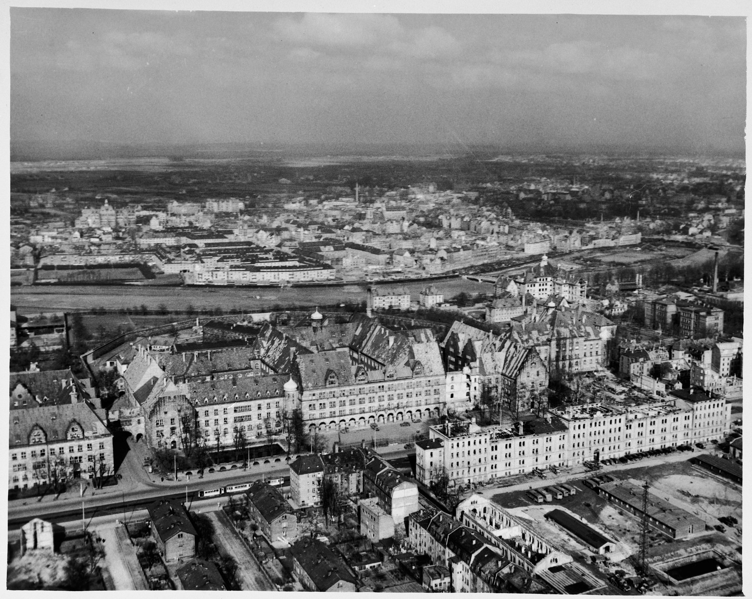 Aerial view of the Nuremberg Palace of Justice.  The lot in the foreground at the right is the Office of the Chief of Counsel Motor Pool, across the street from the court.