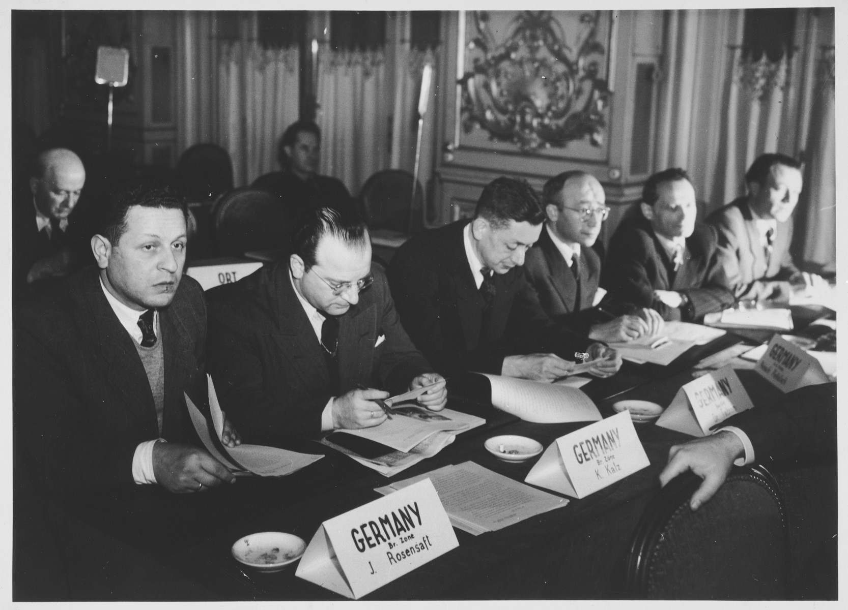 Members of the German delegation attend a conference sponsored by the Joint Distribution Committee on the status of the Jewish populations of Europe and North Africa.  Pictured from left to right are: K. Katz, Norbert Wollheim, Hans Fabian, Peisach Piekatsch and Chaskiel Eife.
