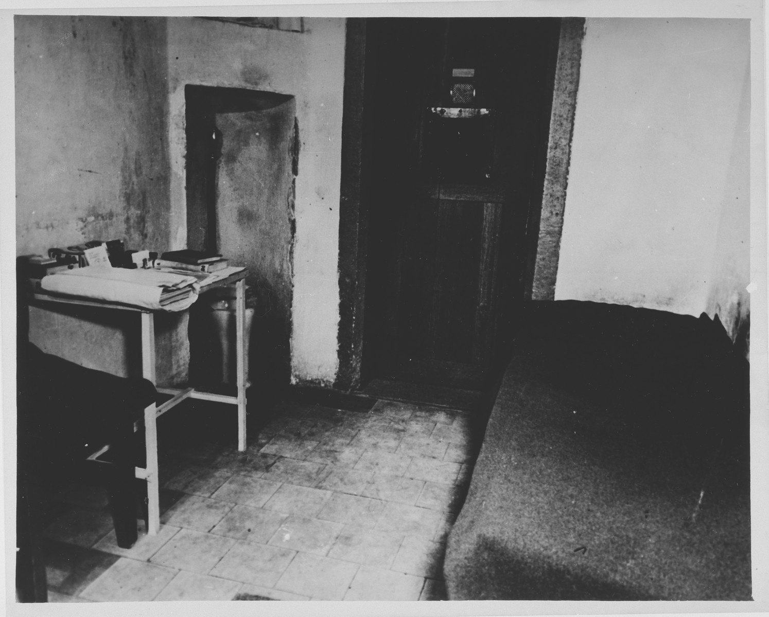 A typical jail cell in the Palace of Justice Prison, where the defendants were confined during the International Military Tribunal trial of war criminals at Nuremberg.  IMT defendant Robert Ley hanged himself on the piece of pipe extending from the toilet