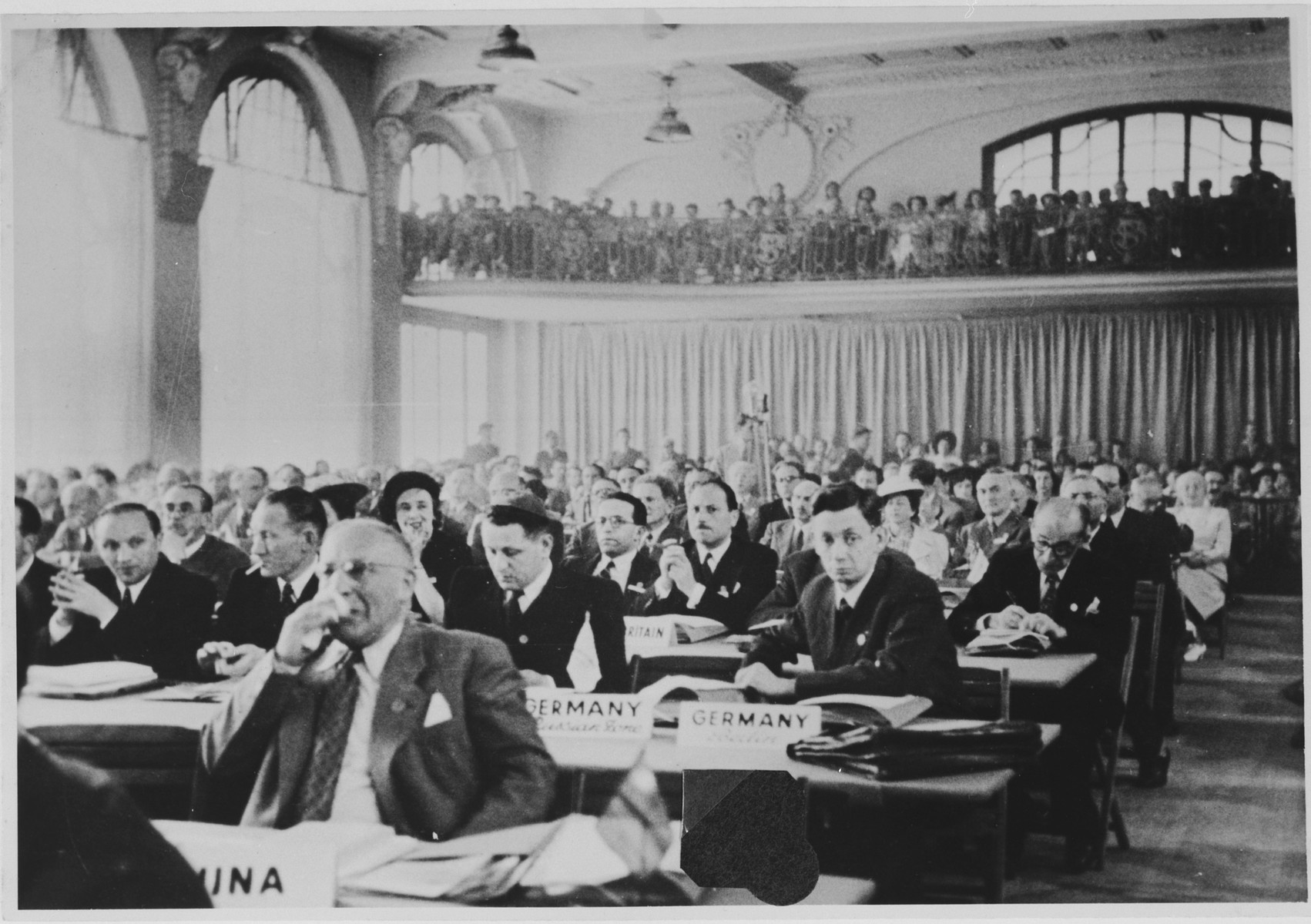 Jewish leaders attend a meeting of the World Jewish Congress in Montreux, Switzerland.  Among those pictured are German-Jewish delegates, Hans Fabian (second row from the front, right) and Heinz Gelinsky (next to Fabian).   Josef Rosensaft, is at the extreme left in the second row; next to him is Bernard (Dov or Berl) Laufer (smoking a cigarette), and next to him - second from the aisle - is Samuel Weintraub.