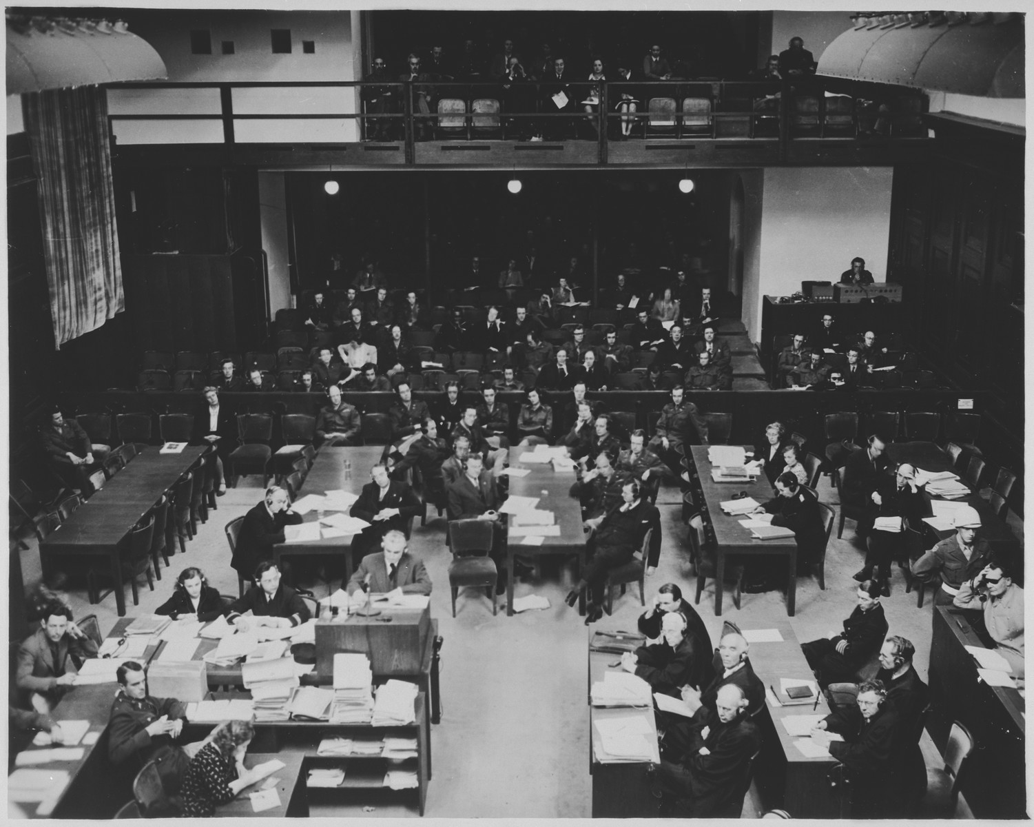 View of the courtroom during a session of the International Military Tribunal trial of war criminals at Nuremberg.