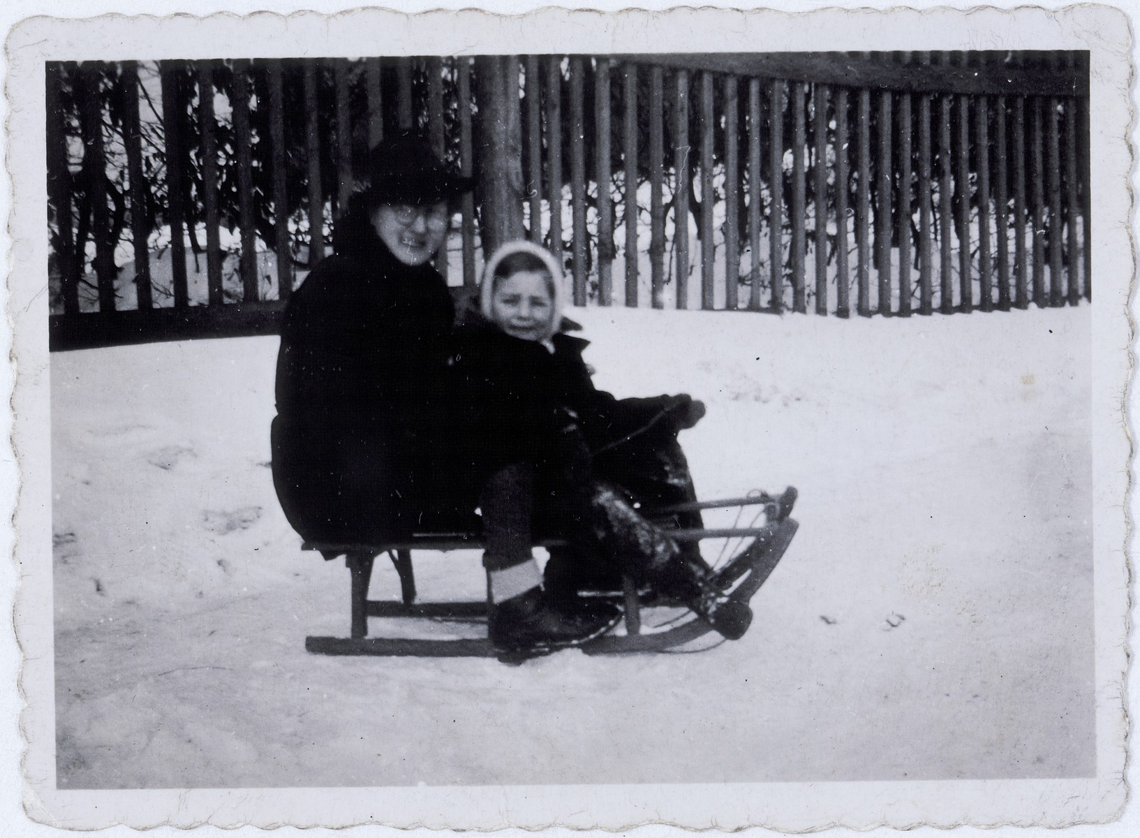 Erna Fritsche Haar and her son Roman Haar on a sled in the Rzeszow Ghetto.