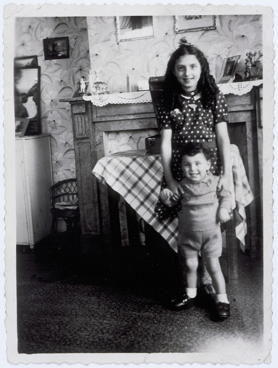 Two Jewish cousins pose in an apartment in Brussels where they are hiding as Christians.  Pictured are Flora Mendelowicz and Nathan (Nounou) Ciechanow.