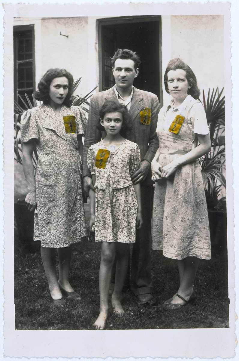 Members of a Jewish family pose outside their home in Zagreb wearing the rectangular, yellow Jewish badges required by the Croatian regime.  Pictured clockwise from the left: are Irma Deutsch, Salamon Basch, Silva (Deutsch) Basch and Edita Deutsch (daughter of Irma).