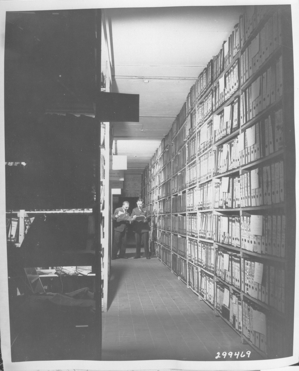 American researchers at the Berlin Document Center peruse captured German records that are to be used as evidence in the war crimes trials.