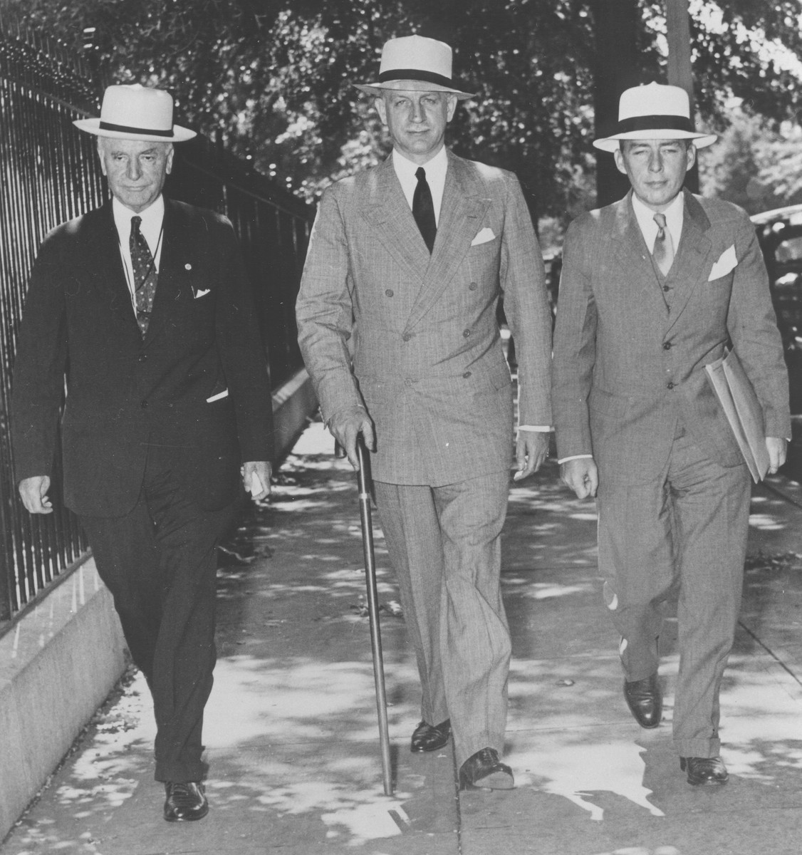Secretary of State Cordell Hull (left), Under Secretary Sumner Welles, and Assistant Secretary Adolf Berle (right) arrive at the White House where they will witness Roosevelt's signing of the Neutrality Proclamation.