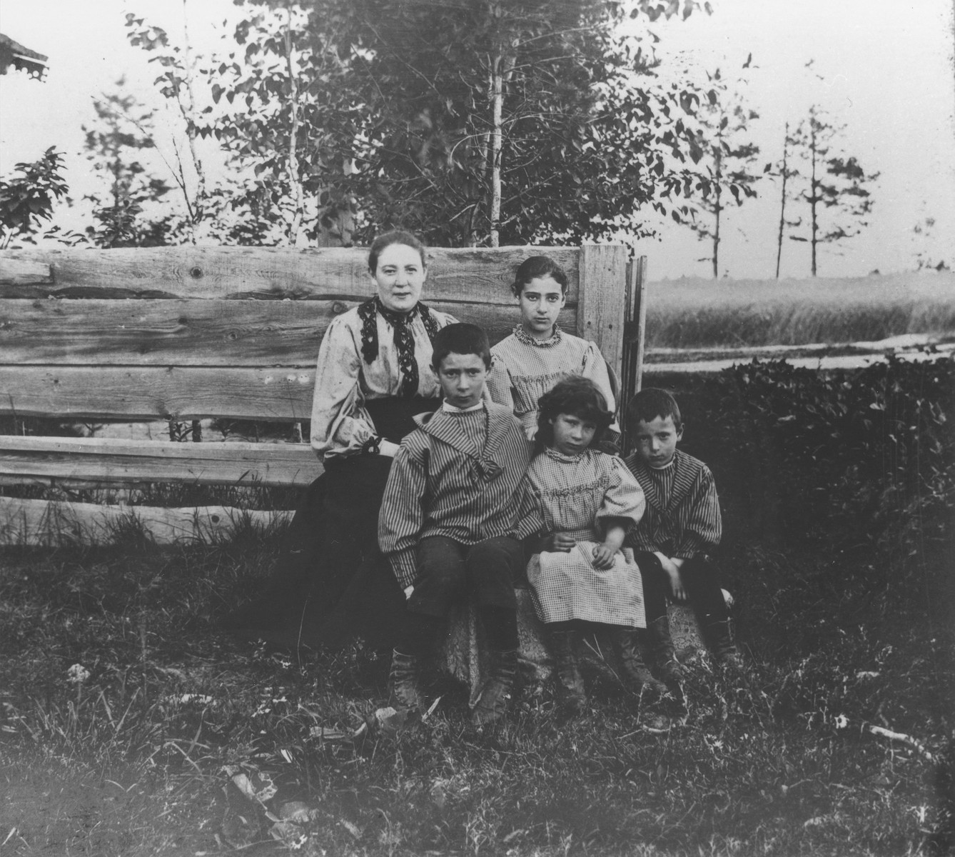 Group portrait of the Mikolaevsky family at their dacha in the village of Strelna, a suburb of St. Petersburg.