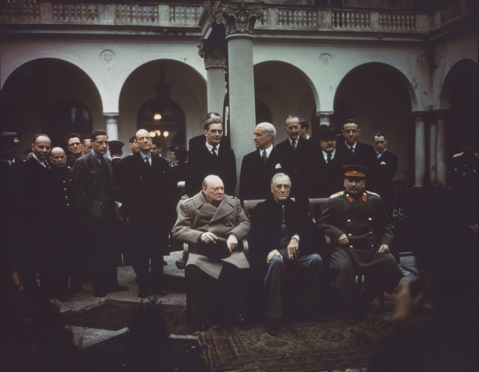 British Prime Minister Winston Churchill, U.S. President Franklin D. Roosevelt, and Soviet Premier Joseph Stalin pose outside on the grounds of the Livadia Palace during the Yalta Conference.