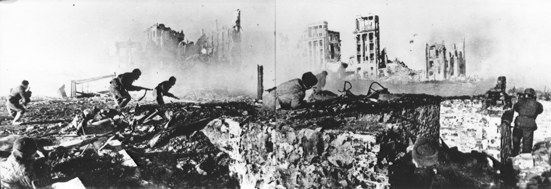 """Assault units of the 62nd Soviet army battle the Germans in Stalingrad.  Sovfoto caption reads: """"Assault groups of the 62nd army dislodge the Germans from house after house, basement after basement, tightening the iron ring around them."""""""