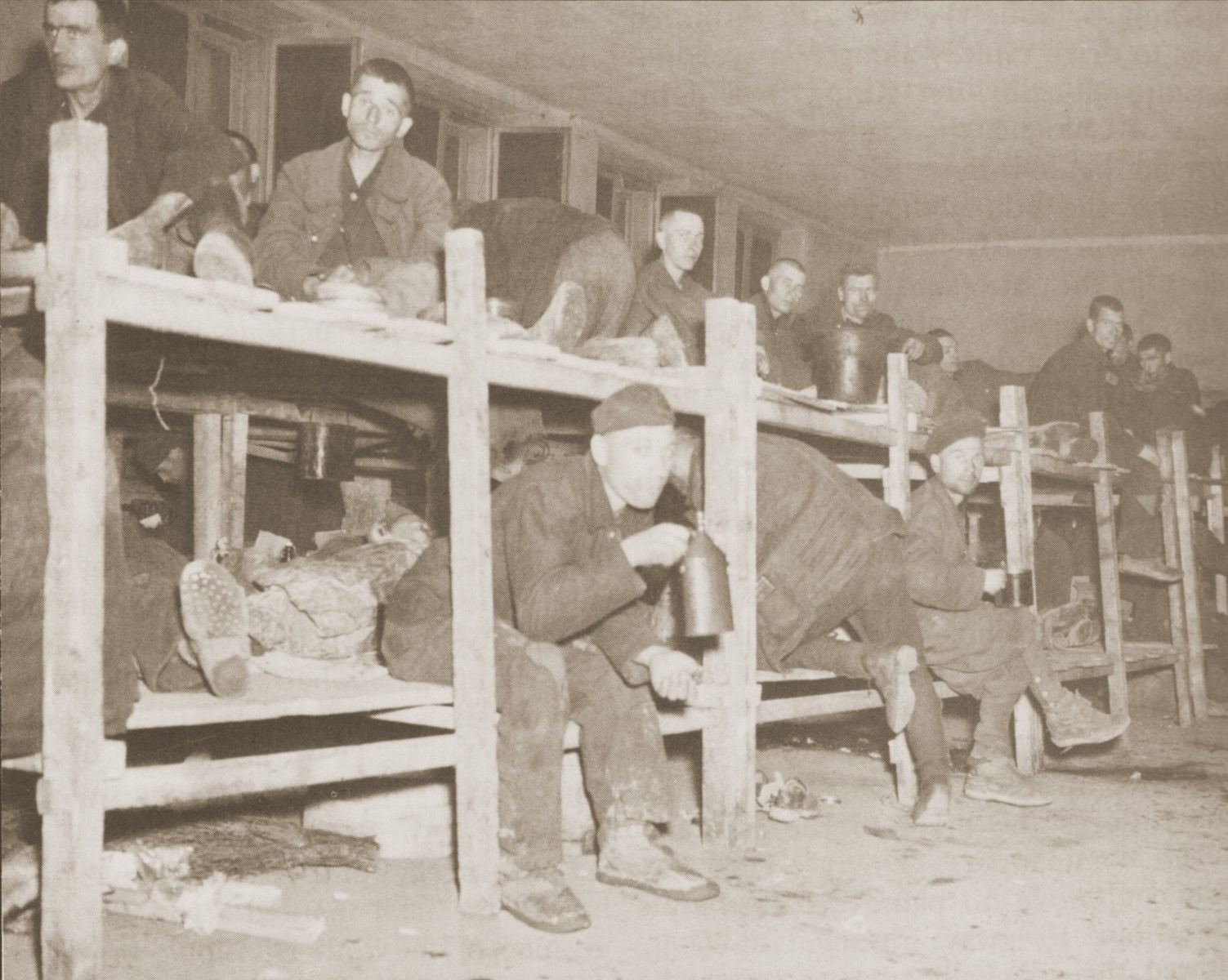 Soviet POWs sit on their bunks shortly after their liberation by the U.S. Ninth Army.