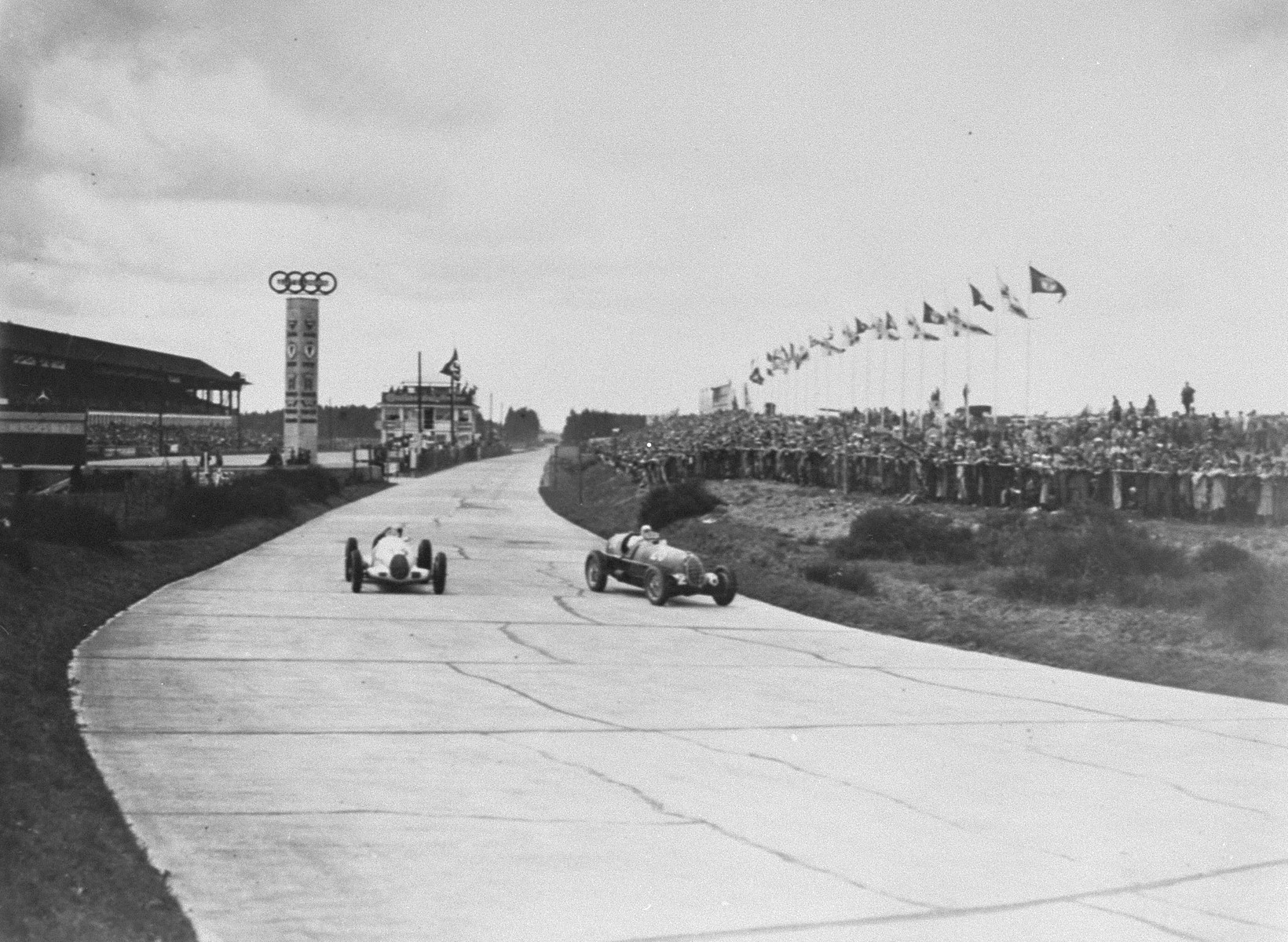 Auto racing at the 11th Olympiad.